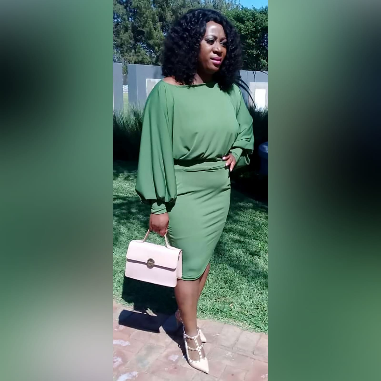 Green knee length smart casual dress 3 green knee length smart casual dress with long bounce sleeves and bodice with a fitted bottom skirt