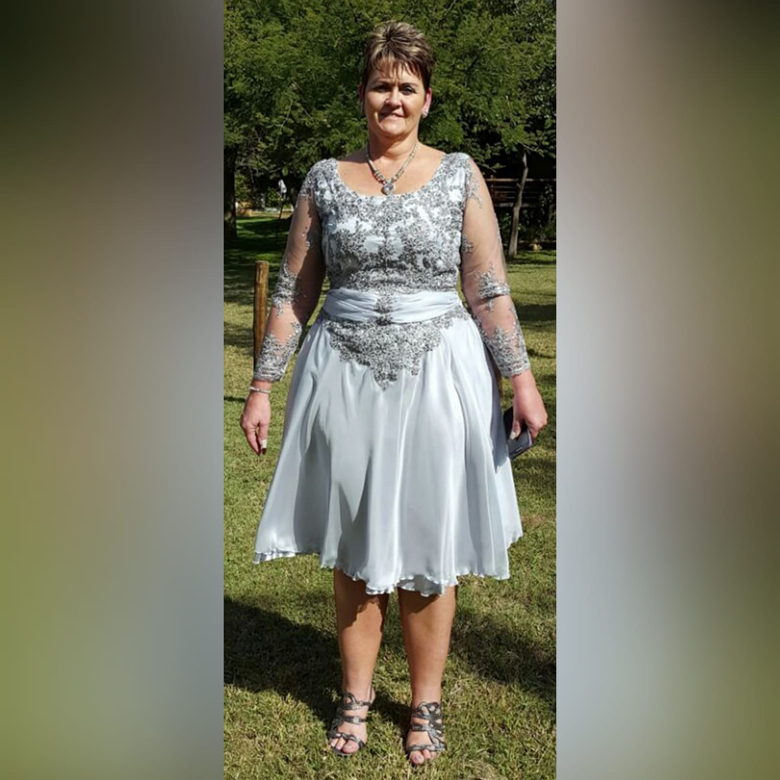 Grey knee length mother of the bride dress 1 grey knee length mother of the bride dress detailed with a ruched belt and lace on the bodice and sleeves.