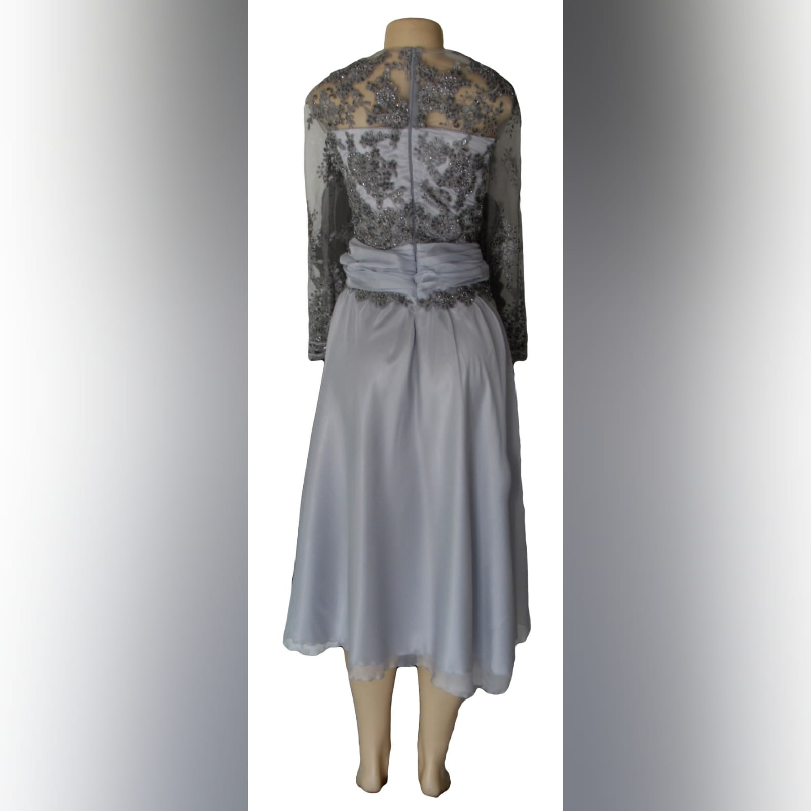 Grey knee length mother of the bride dress 5 grey knee length mother of the bride dress detailed with a ruched belt and lace on the bodice and sleeves.