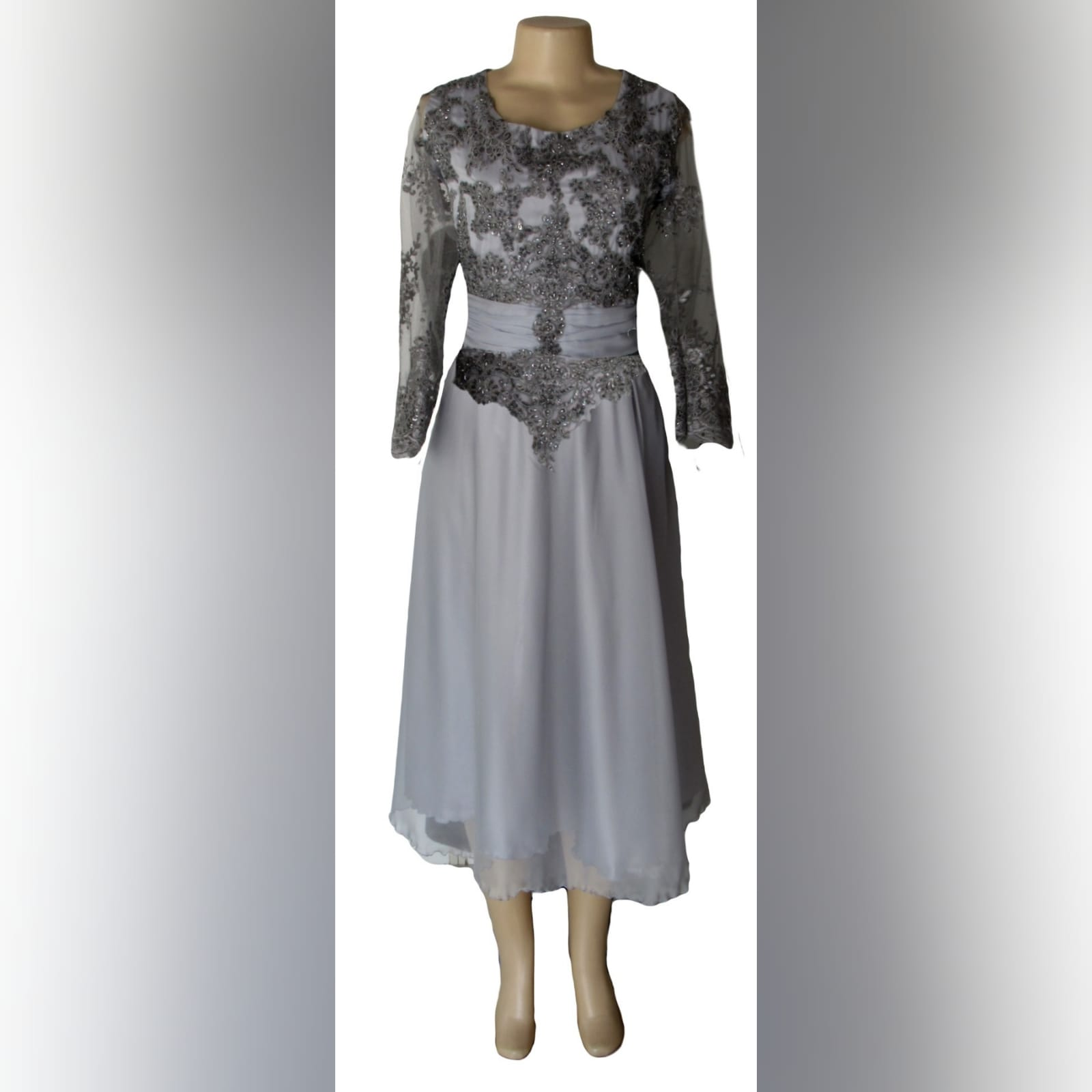 Grey knee length mother of the bride dress 6 grey knee length mother of the bride dress detailed with a ruched belt and lace on the bodice and sleeves.