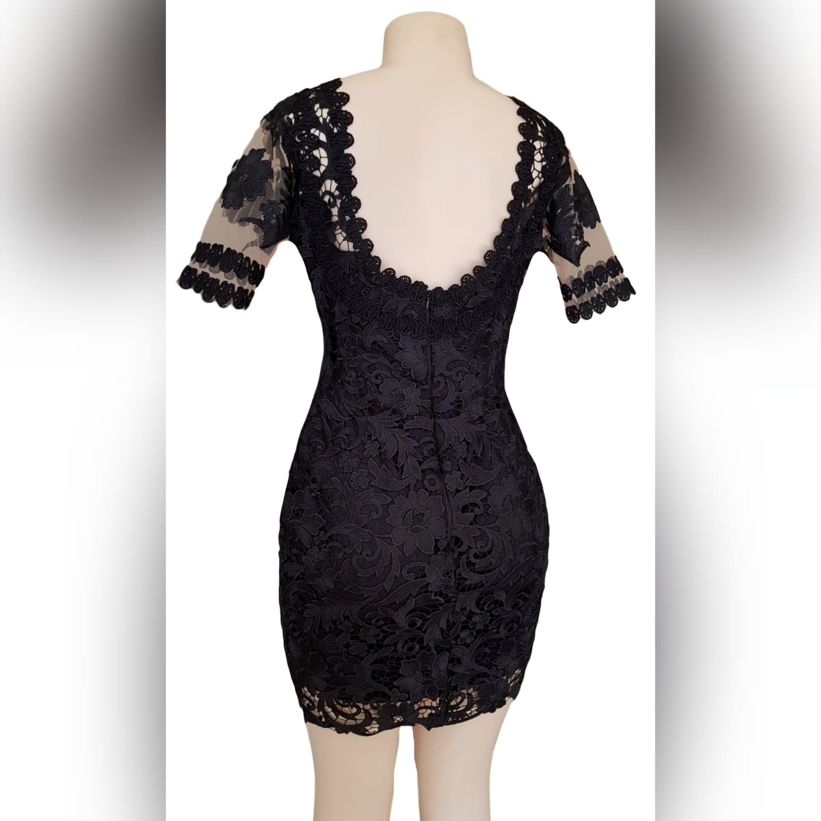 Black short guipure lace evening dress 2 black short guipure lace evening dress with a rounded front and back neckline. With sheers short sleeves detailed with lace.