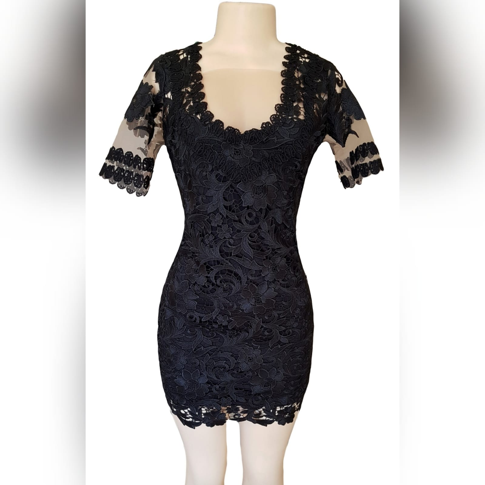 Black short guipure lace evening dress 1 black short guipure lace evening dress with a rounded front and back neckline. With sheers short sleeves detailed with lace.