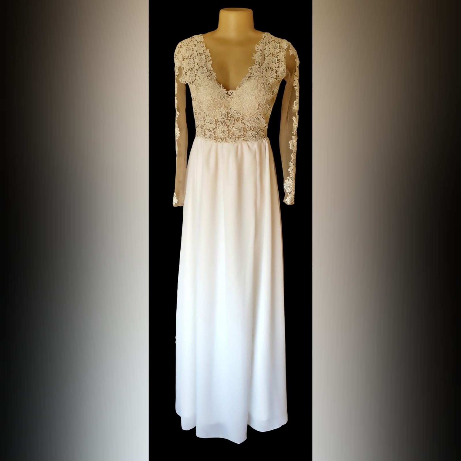 Ivory long chiffon and lace prom dress 2 ivory long chiffon and lace prom dress, with an illusion lace bodice with a rounded open back, long sheer sleeves detailed with lace, and a slit.