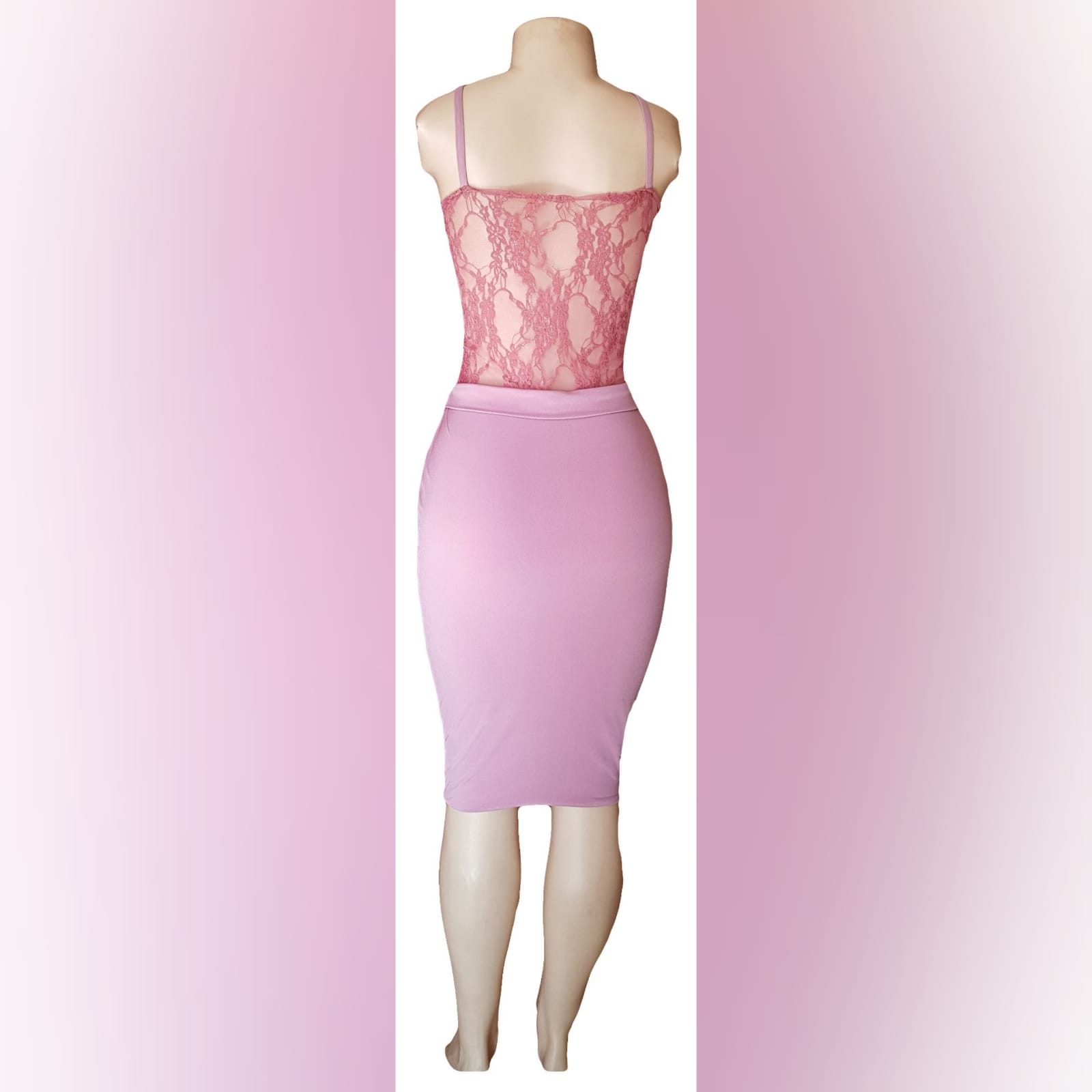 Knee length pink fitted smart casual dress 3 knee length pink fitted smart casual dress with a sheer lace bodice with a waistband and shoulder straps.