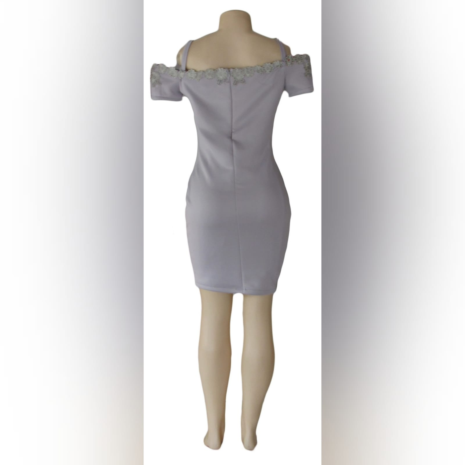 Light grey short fitted smart casual dress 2 light grey short fitted smart casual dress, with off shoulder shorter sleeves and shoulder straps. Neckline detailed with silver lace.