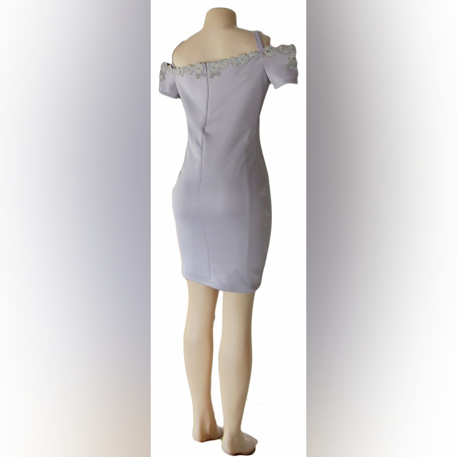 Light grey short fitted smart casual dress 6 light grey short fitted smart casual dress, with off shoulder shorter sleeves and shoulder straps. Neckline detailed with silver lace.