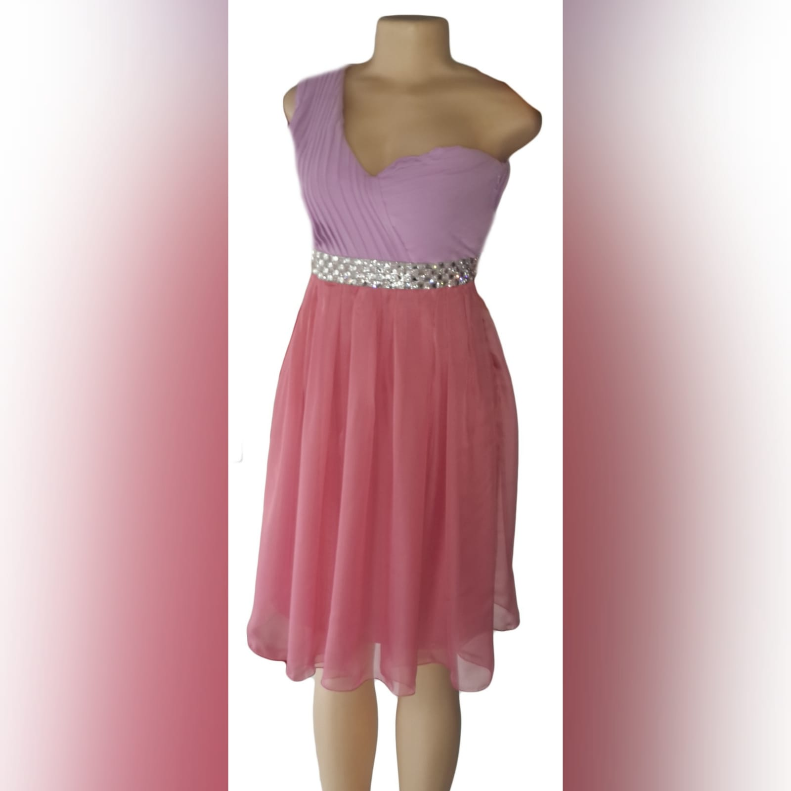 Lilac & dusty pink pink chiffon bridesmaid dress 1 lilac & dusty pink pink chiffon bridesmaid dress with a single shoulder sweetheart neckline. Pleated bodice with a silver belt bling detail.