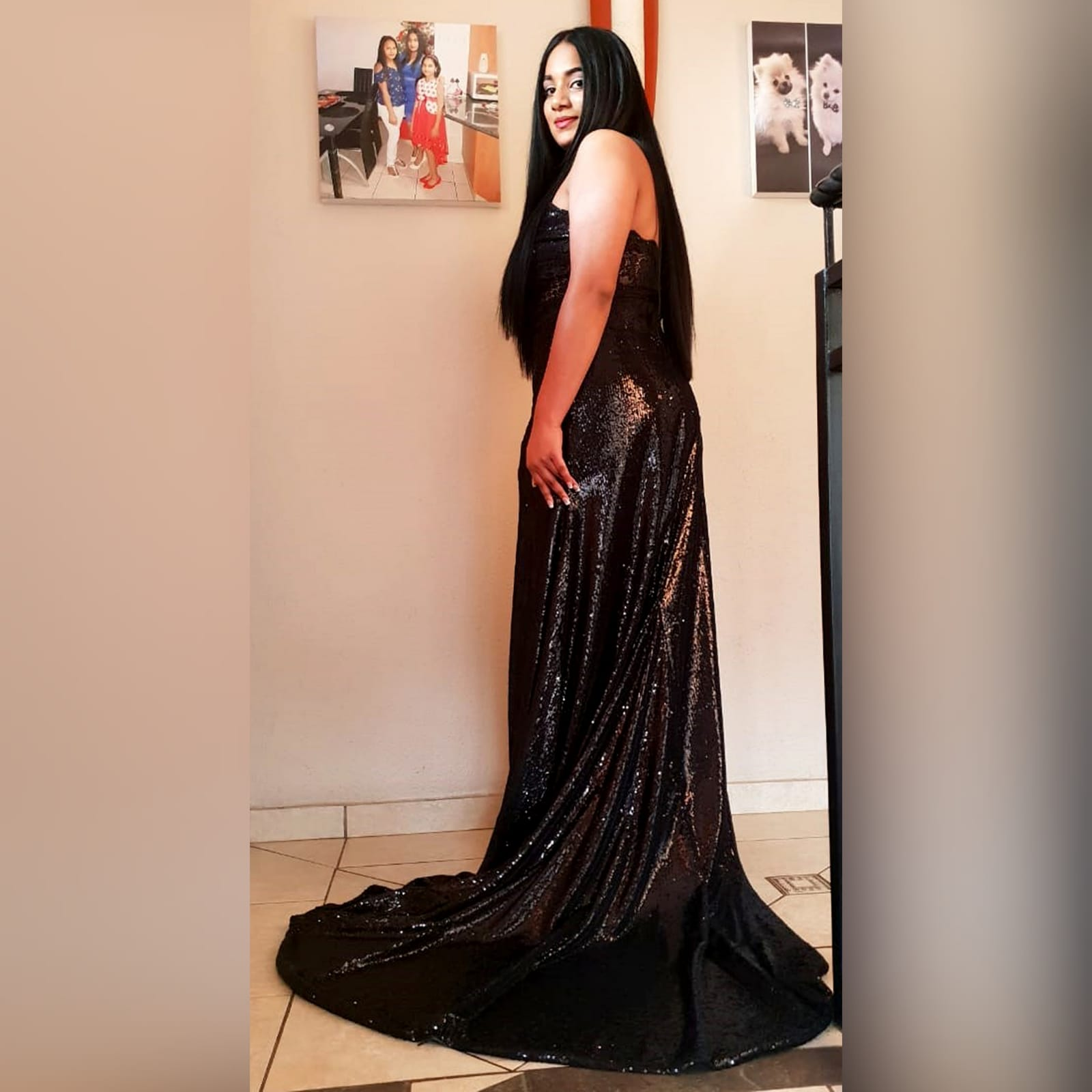 Long black sequins boob tube prom dress 2 long black sequins boob tube prom dress with a sheer lace back and side tummy. High slit and a train.