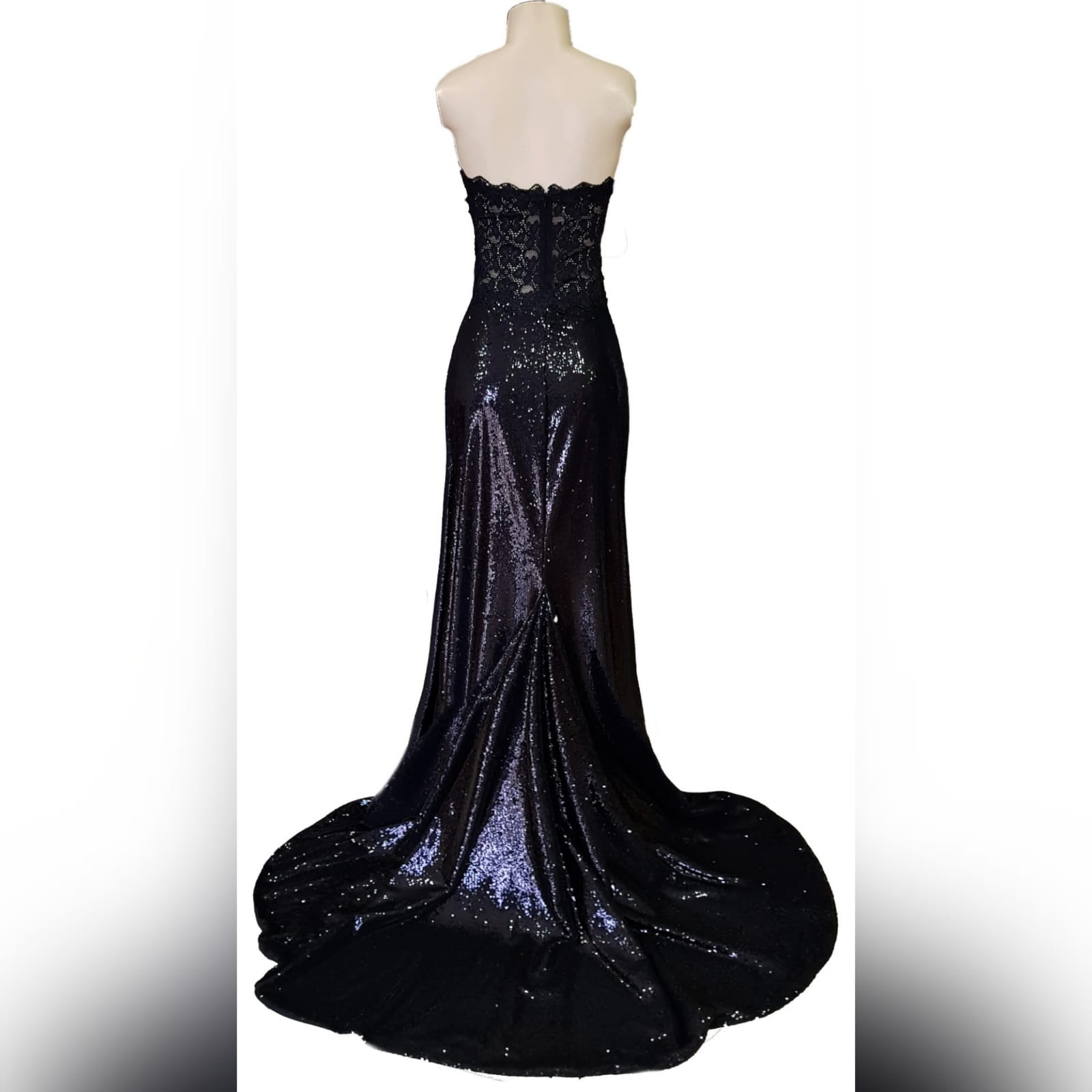 Long black sequins boob tube prom dress 8 long black sequins boob tube prom dress with a sheer lace back and side tummy. High slit and a train.
