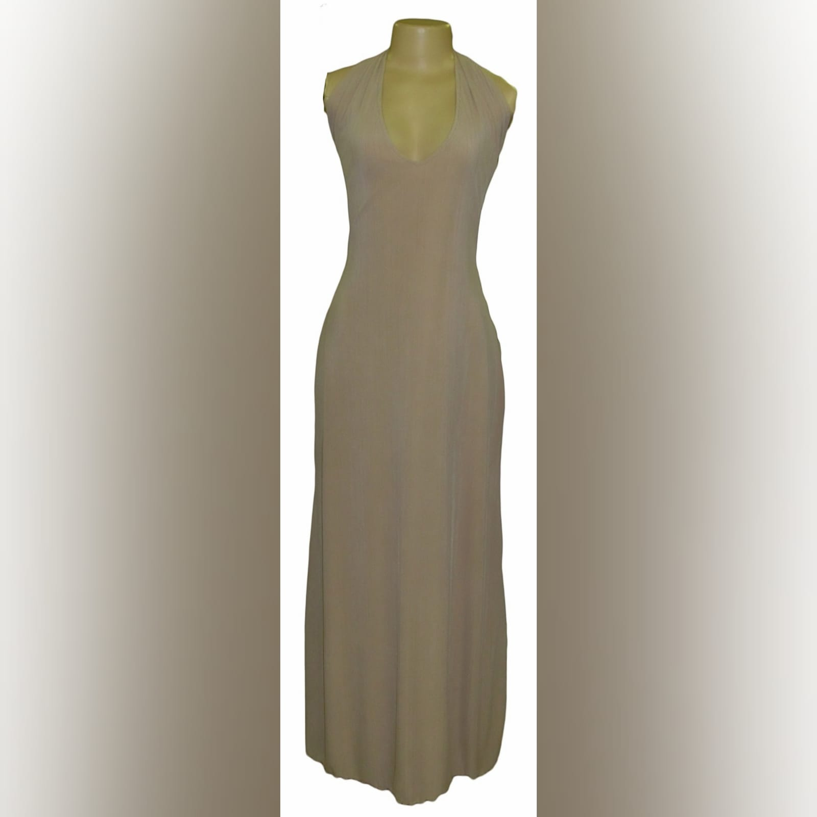 Long halter neck beige smart casual dress 4 long halter neck beige smart casual dress with a tie up open back and a back slit