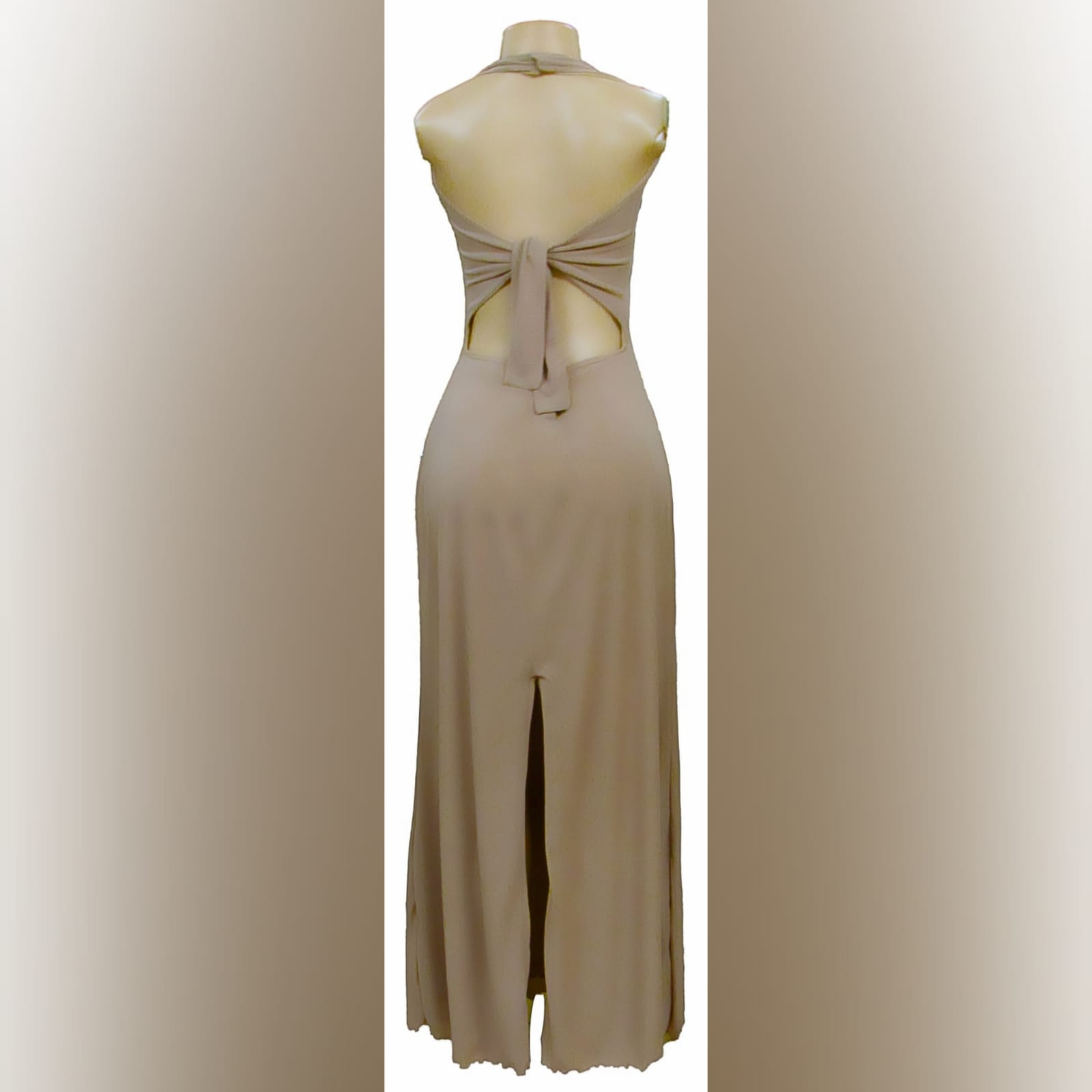Long halter neck beige smart casual dress 2 long halter neck beige smart casual dress with a tie up open back and a back slit