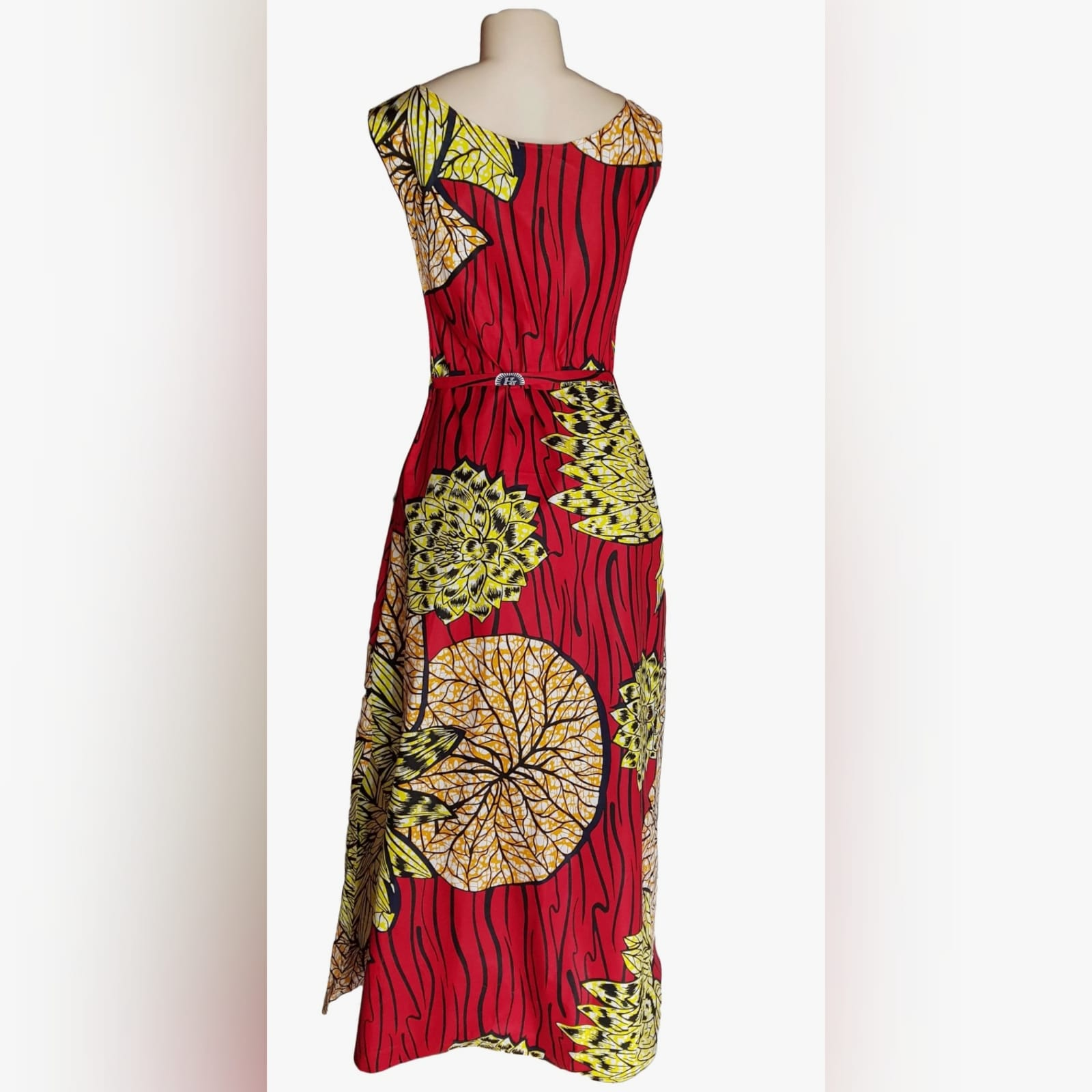"""Long red and yellow angolan print summer dress 3 brighten up your day and get a spring dress designed and made for you. This long red and yellow angola print summer dress is a comfortable """" feel free"""" design for everyday wear."""