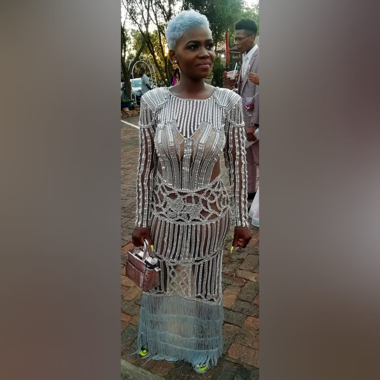 Long sheer fully beaded matric farewell dress with long sleeves 2 long sheer fully beaded matric farewell dress with long sleeves, tassels and a back high slit. With padded shoulders.
