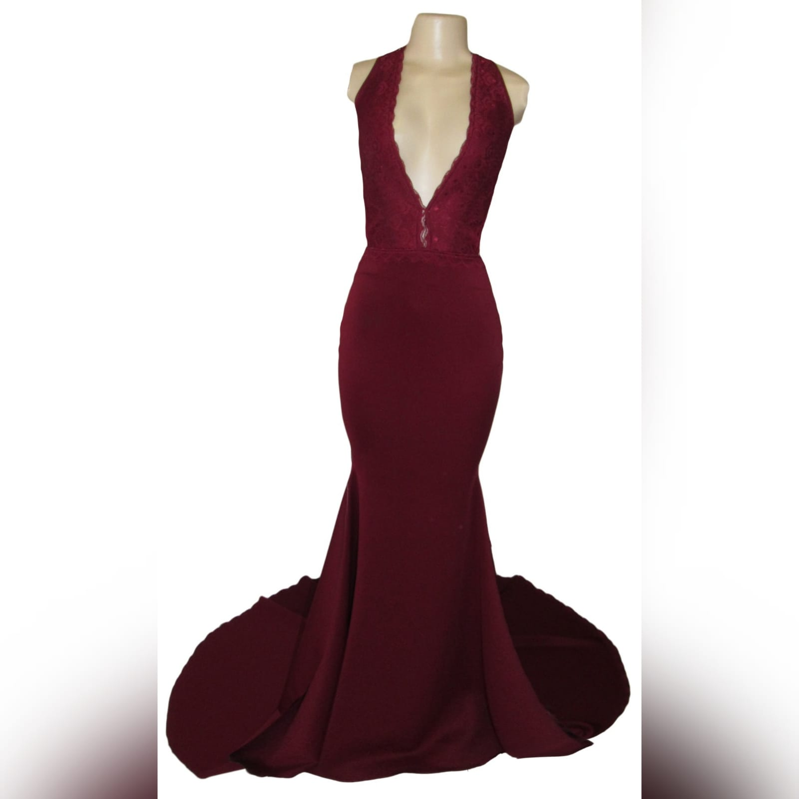 Maroon plunging neckline lace bodice matric dance dress 3 maroon plunging neckline lace bodice, soft mermaid matric dress with a train and an open back detailed with lace straps.