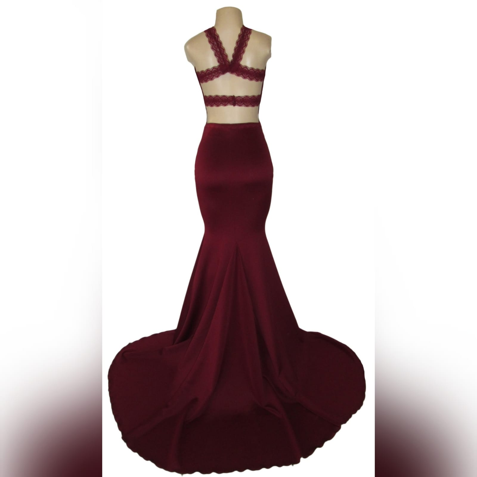 Maroon plunging neckline lace bodice matric dance dress 4 maroon plunging neckline lace bodice, soft mermaid matric dress with a train and an open back detailed with lace straps.