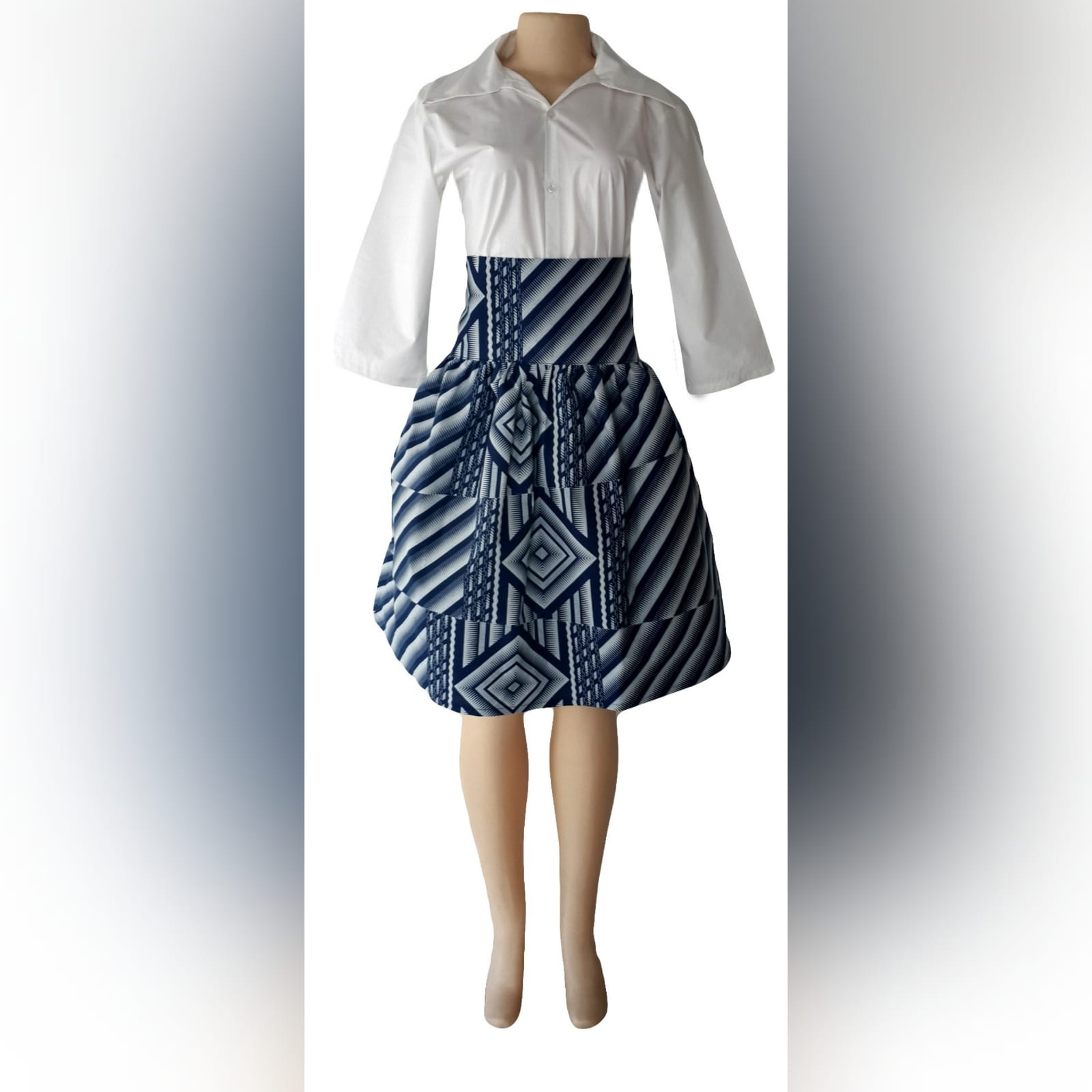 Matching couples traditional shweshwe wedding attire 3 lady: high waisted gathered traditional skirt with white 3/4 sleeve blouse. Gent: trousers and shirt with detailed collar, cuffs and elbow patches. Traditional wedding attire.