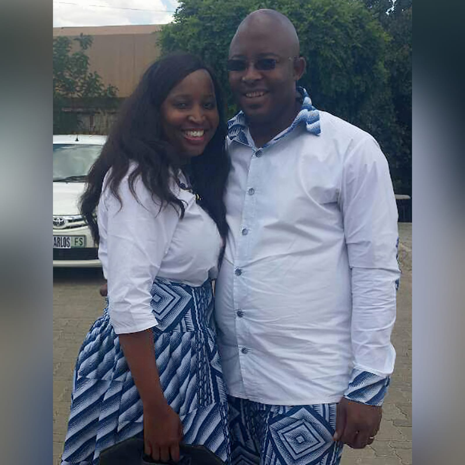 Matching couples traditional shweshwe wedding attire 1 lady: high waisted gathered traditional skirt with white 3/4 sleeve blouse. Gent: trousers and shirt with detailed collar, cuffs and elbow patches. Traditional wedding attire.