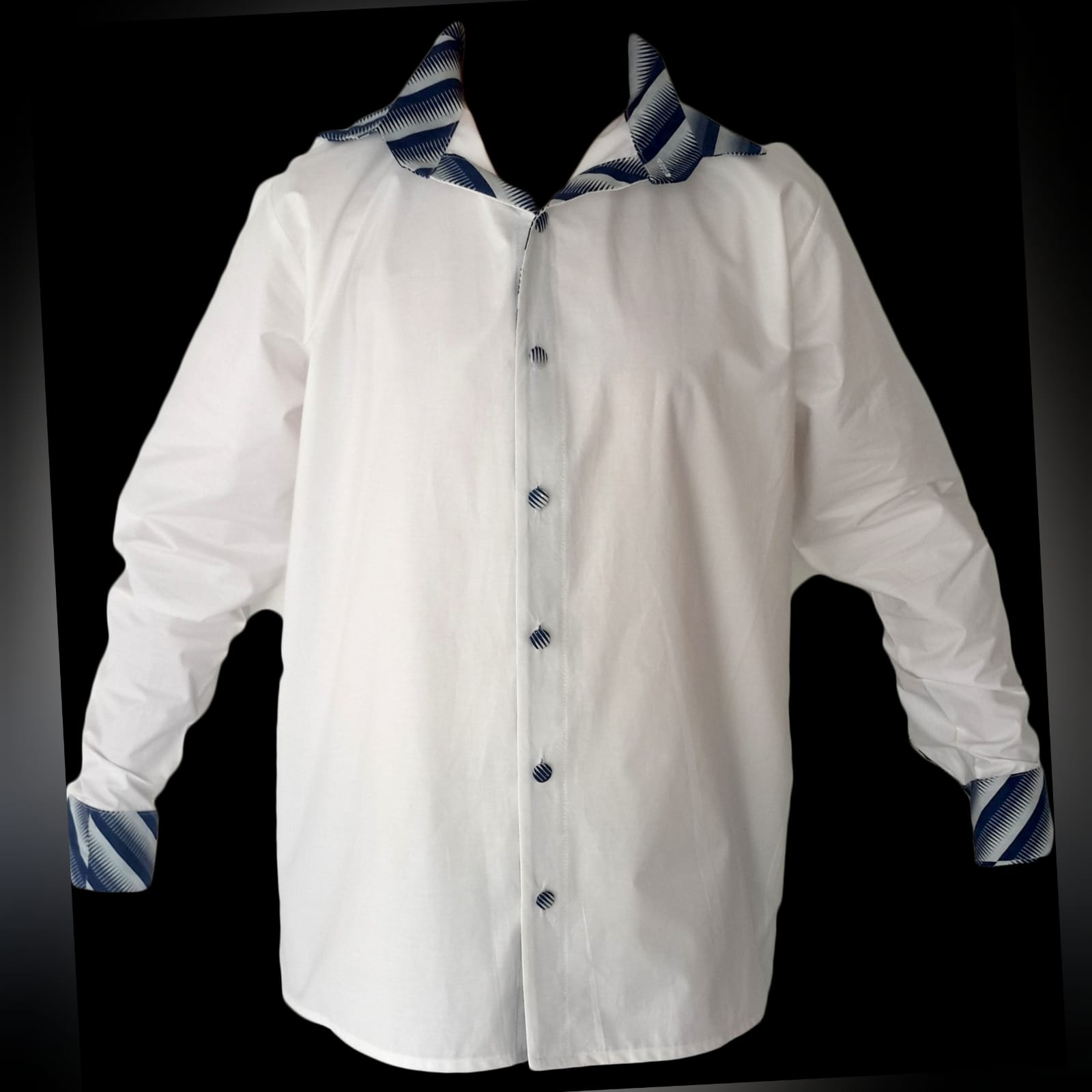Matching couples traditional shweshwe wedding attire 7 lady: high waisted gathered traditional skirt with white 3/4 sleeve blouse. Gent: trousers and shirt with detailed collar, cuffs and elbow patches. Traditional wedding attire.