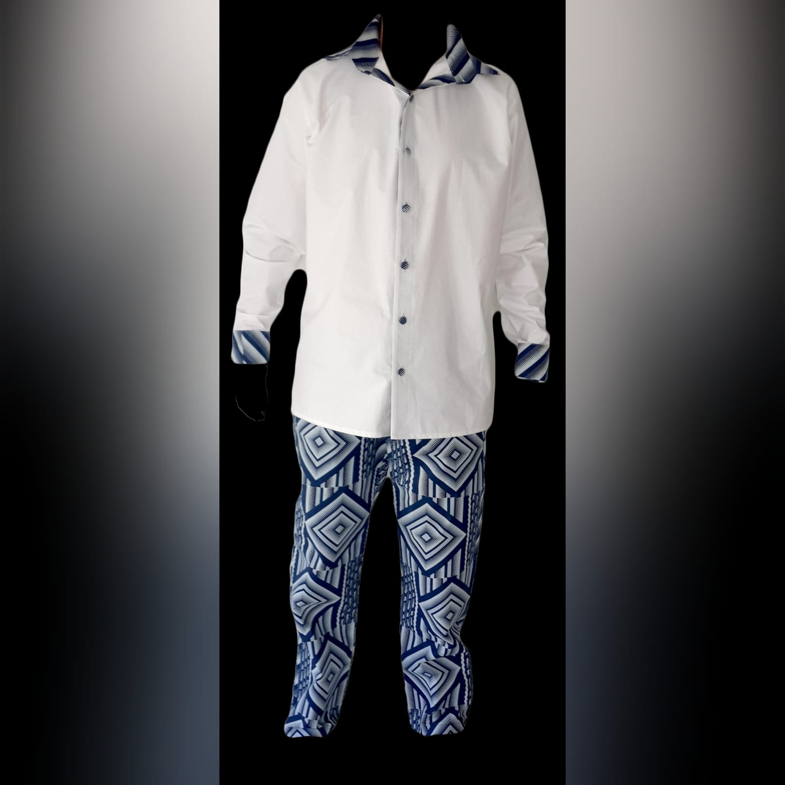 Matching couples traditional shweshwe wedding attire 9 lady: high waisted gathered traditional skirt with white 3/4 sleeve blouse. Gent: trousers and shirt with detailed collar, cuffs and elbow patches. Traditional wedding attire.