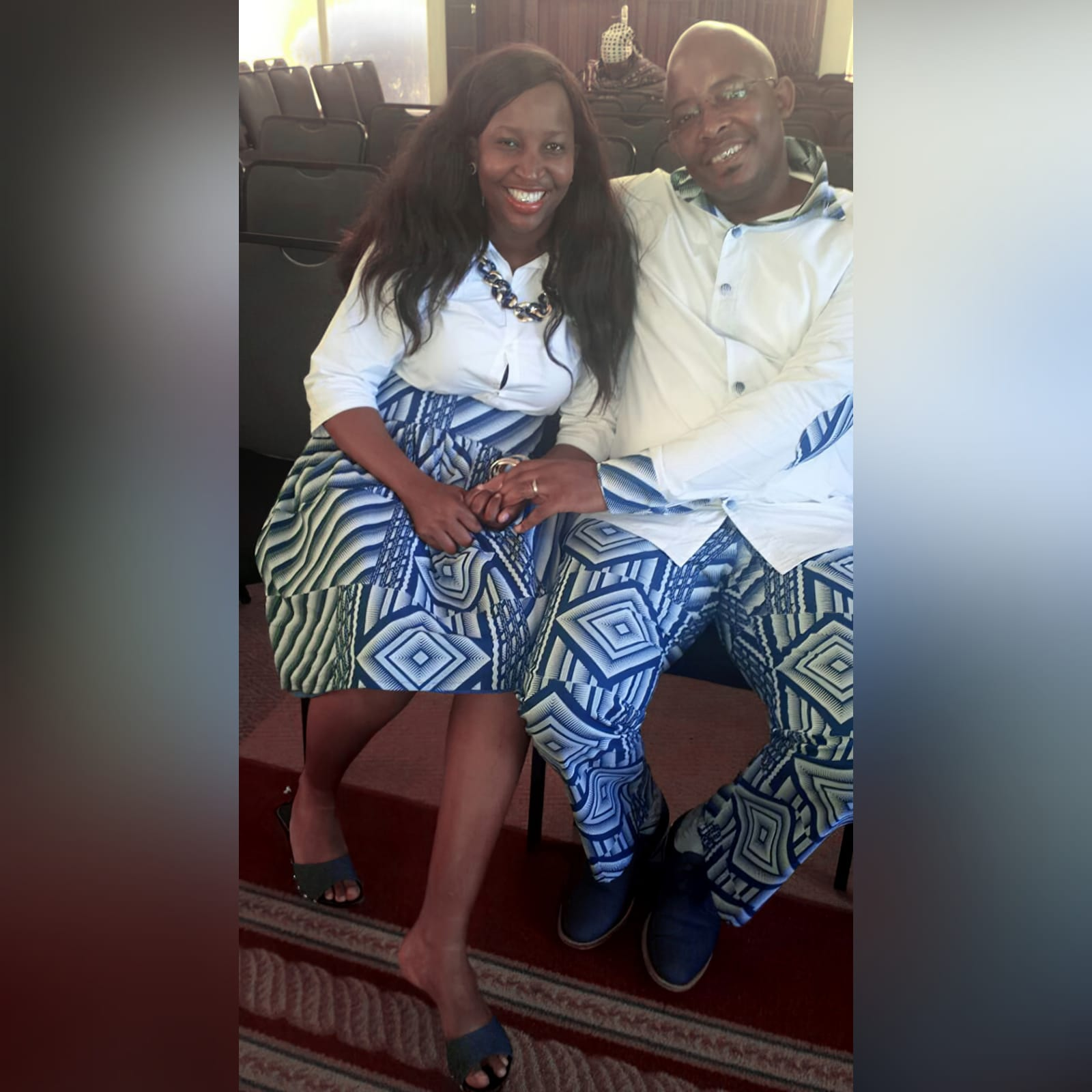 Matching couples traditional shweshwe wedding attire 2 lady: high waisted gathered traditional skirt with white 3/4 sleeve blouse. Gent: trousers and shirt with detailed collar, cuffs and elbow patches. Traditional wedding attire.