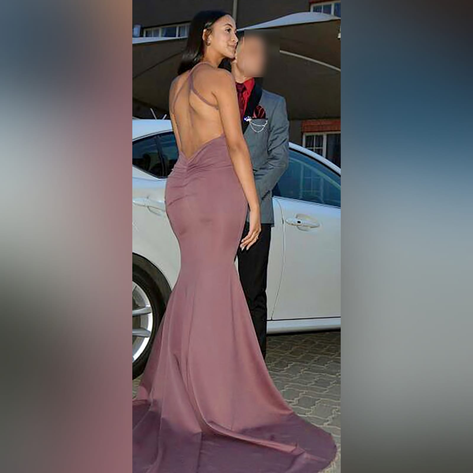 Mauve soft mermaid prom dress 4 mauve soft mermaid prom dress with a low open pleated back with cross strap with a train and a teardrop cleavage opening.