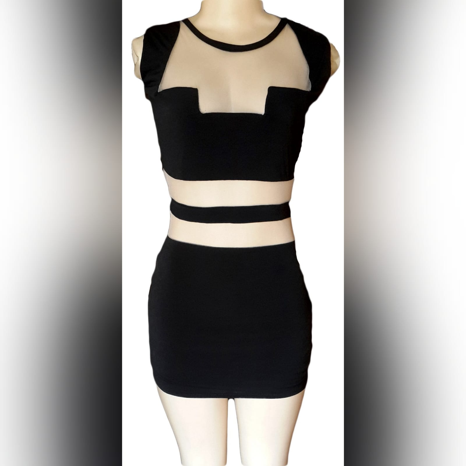 Mini black smart casual dress 1 mini black smart casual dress with see through tummy design and funky neckline