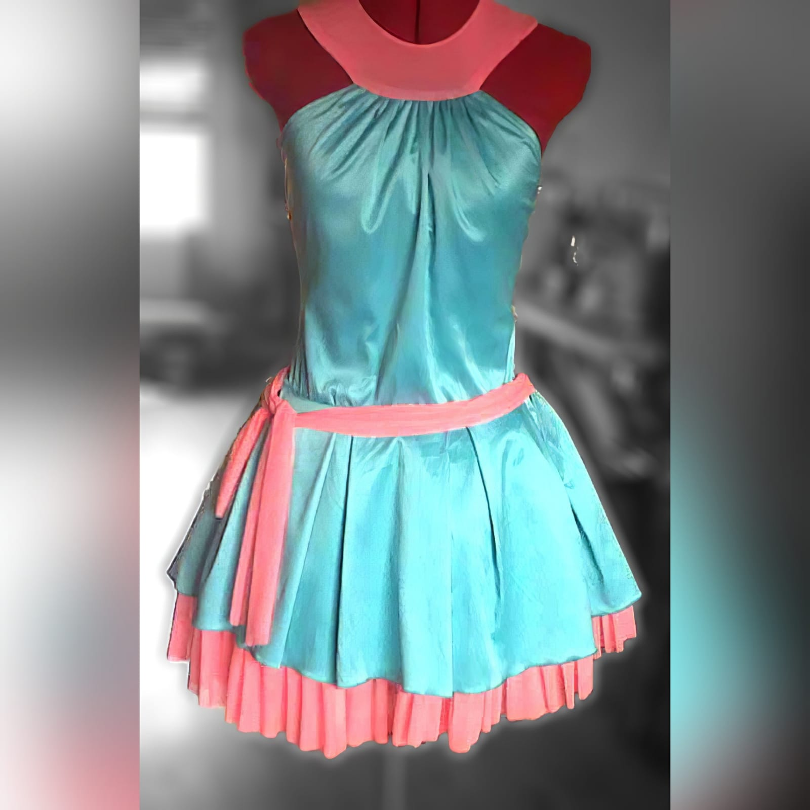 Mint green and coral short party dress 4 mint green and coral short party dress, with a gathered neckline, pleated bottom part with a coral mesh frill, with a diamond open back and a tie-up belt.
