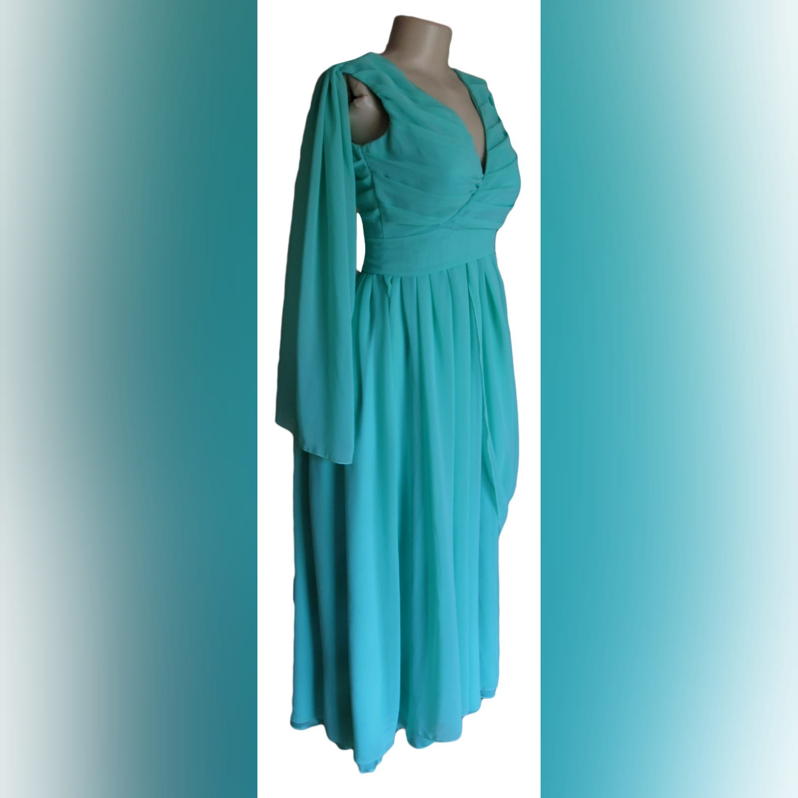 Mint green, long draped mother of the brides dress 3 mint green, long draped mother of the brides dress. With a crossed bust v neckline. Shoulder and hip draping detail.