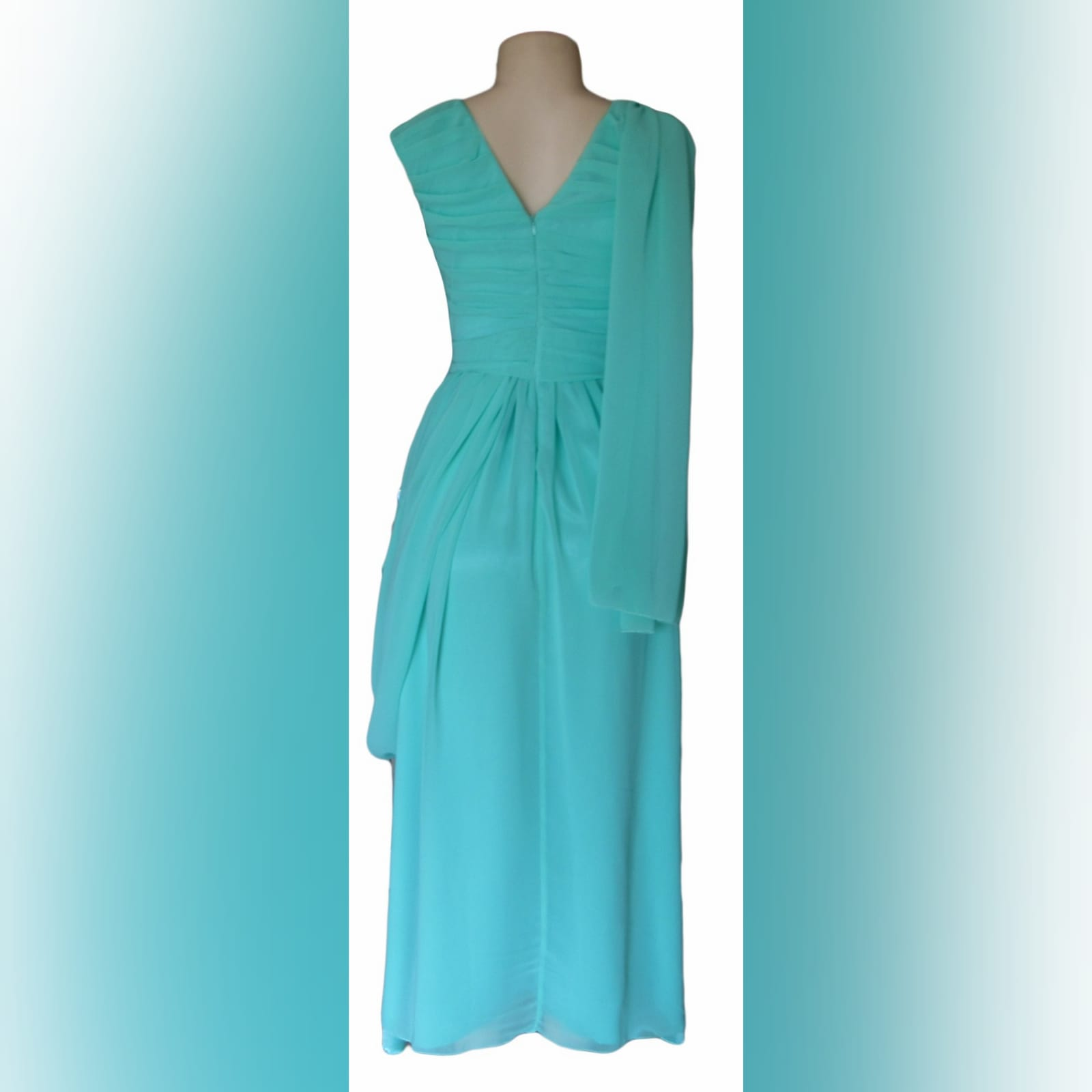 Mint green, long draped mother of the brides dress 2 mint green, long draped mother of the brides dress. With a crossed bust v neckline. Shoulder and hip draping detail.