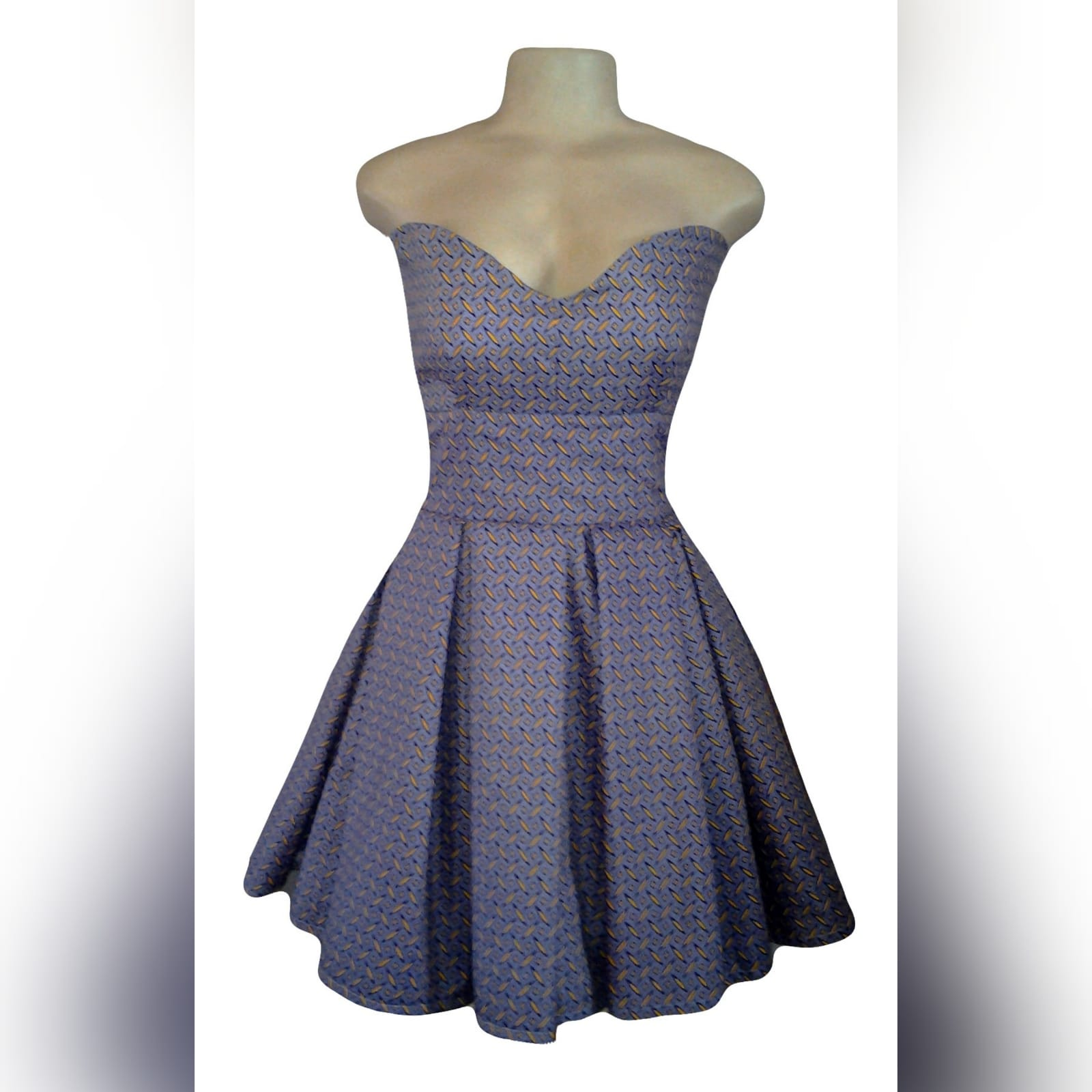 Modern purple traditional shweshwe dress 1 shweshwe traditional boob tube dress with a curvy sweetheart neckline and pleated bottom.