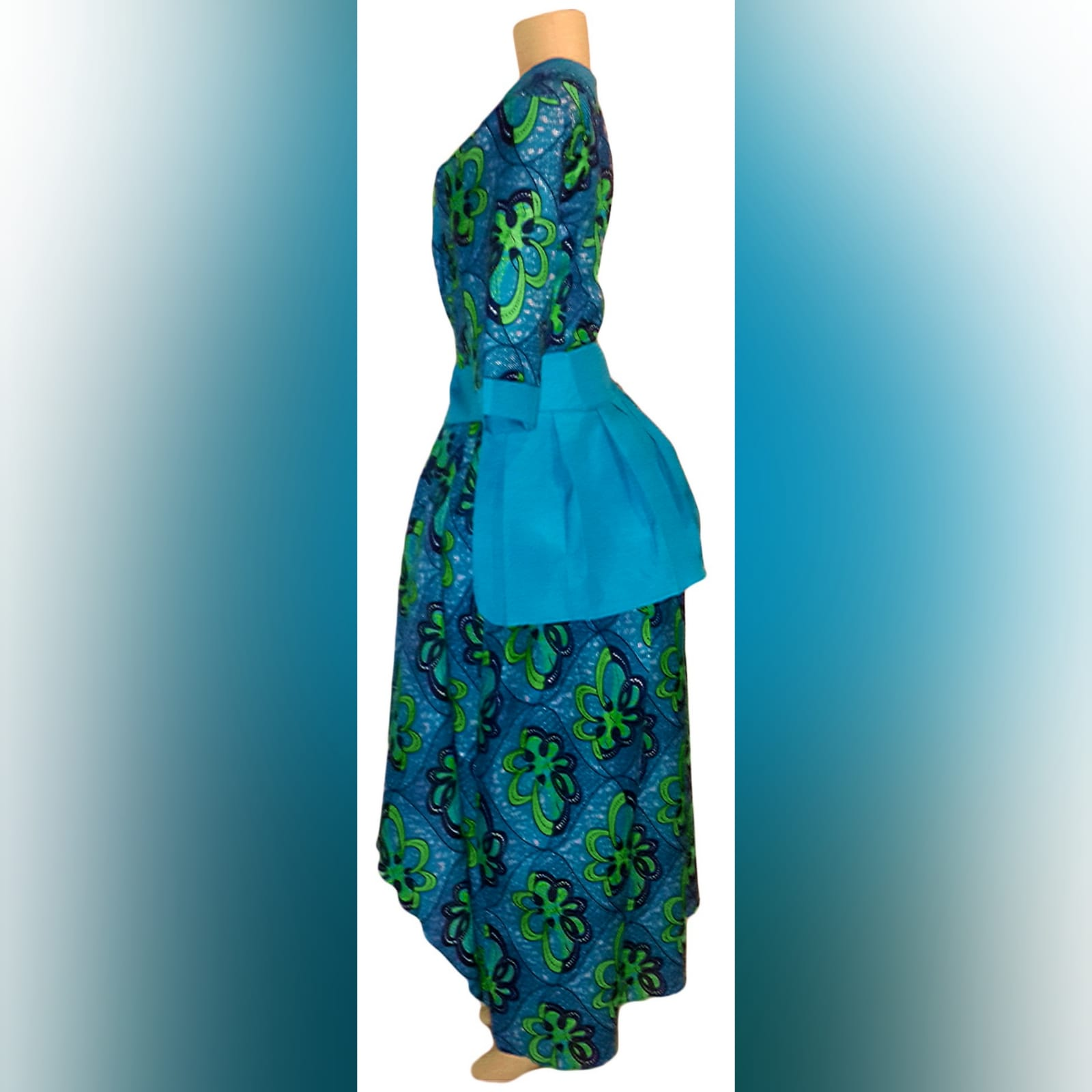Modern traditional green and blue high low dress 2 modern traditional green and blue hi lo dress with a v neckline, 3/4 sleeves and a back peplum with a waistbelt. Matching doek.