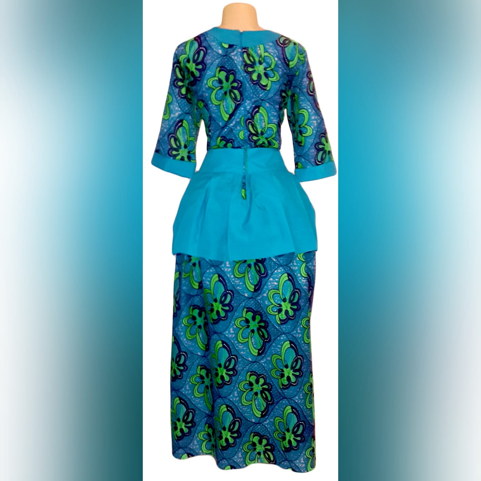 Modern traditional green and blue high low dress 3 modern traditional green and blue hi lo dress with a v neckline, 3/4 sleeves and a back peplum with a waistbelt. Matching doek.