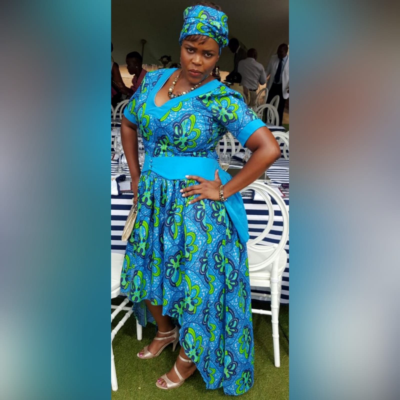 Modern traditional green and blue high low dress 1 modern traditional green and blue hi lo dress with a v neckline, 3/4 sleeves and a back peplum with a waistbelt. Matching doek.