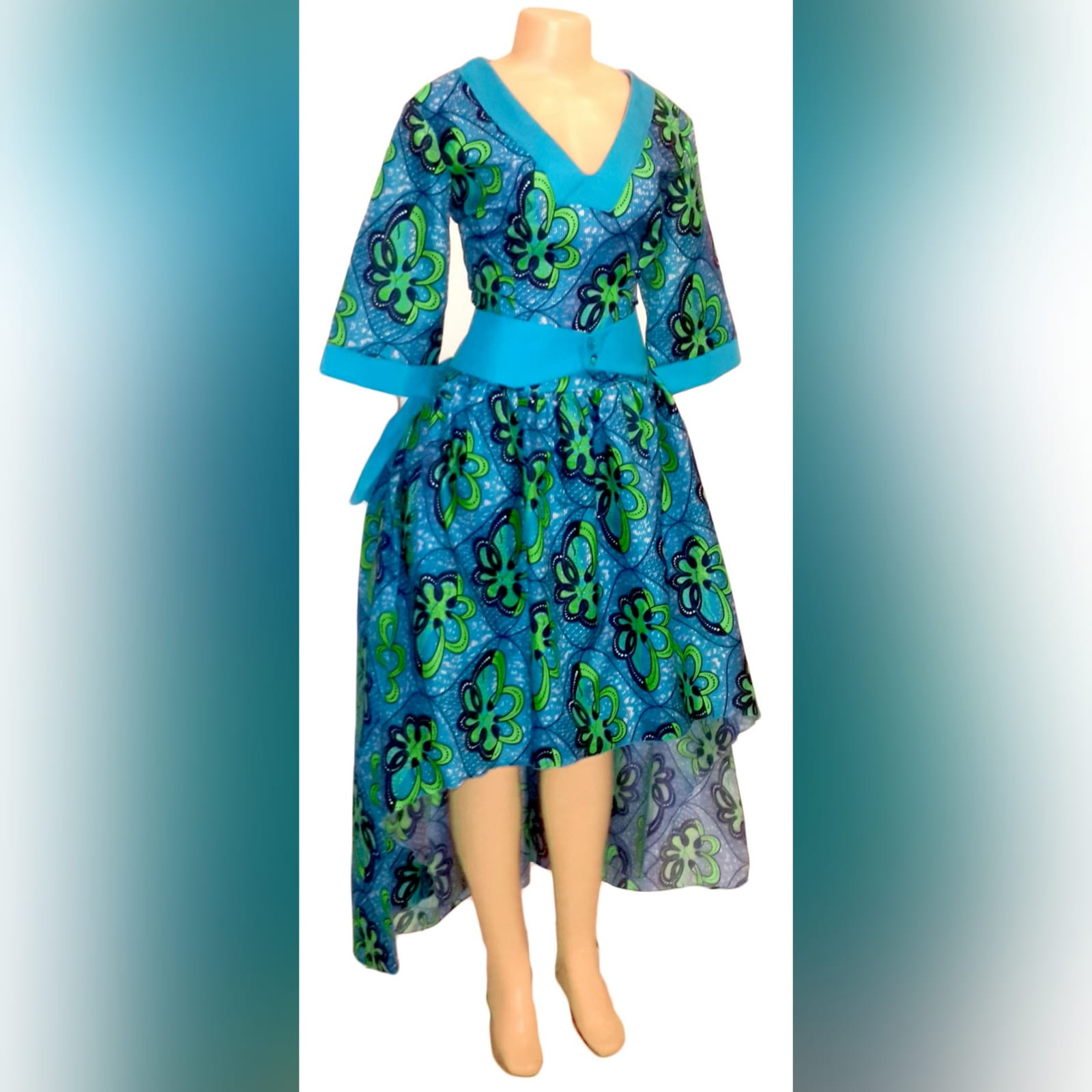 Modern traditional green and blue high low dress 5 modern traditional green and blue hi lo dress with a v neckline, 3/4 sleeves and a back peplum with a waistbelt. Matching doek.