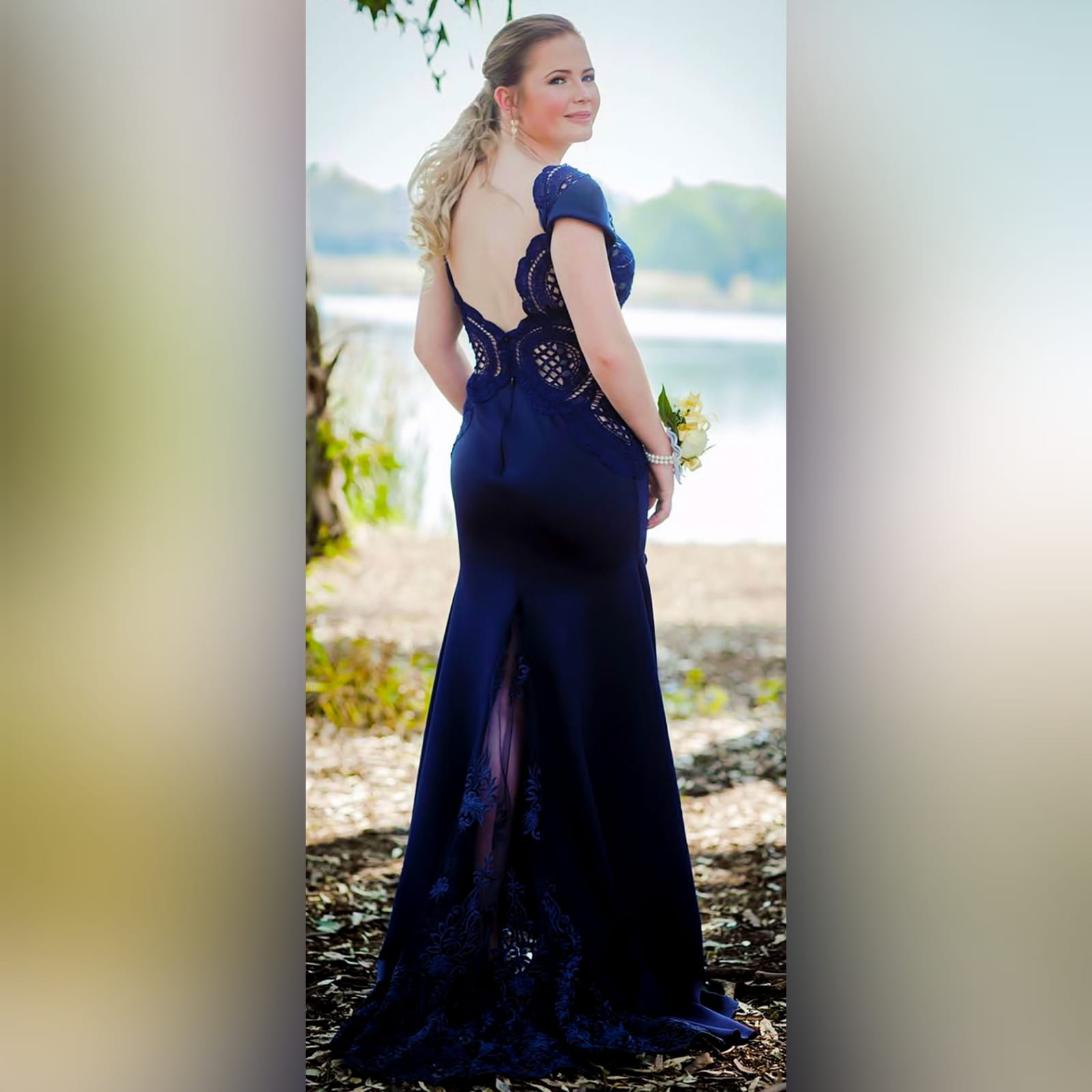 Navy blue long flowy dress with lace bodice 5 navy blue long flowy dress with lace bodice, v neckline & low v open back with a slit.