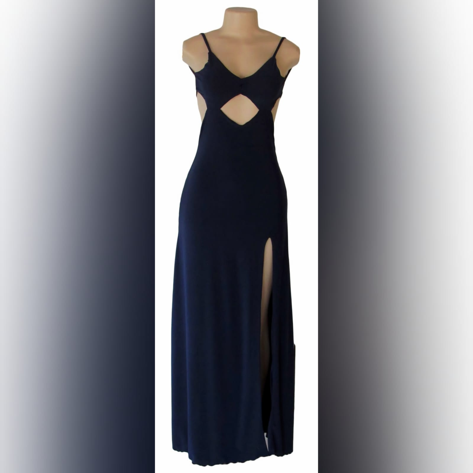Navy blue long sexy evening dress 5 navy blue long sexy evening dress, with a low open back, side tummy openings and a diamond shaped opening under the bust. With a high slit