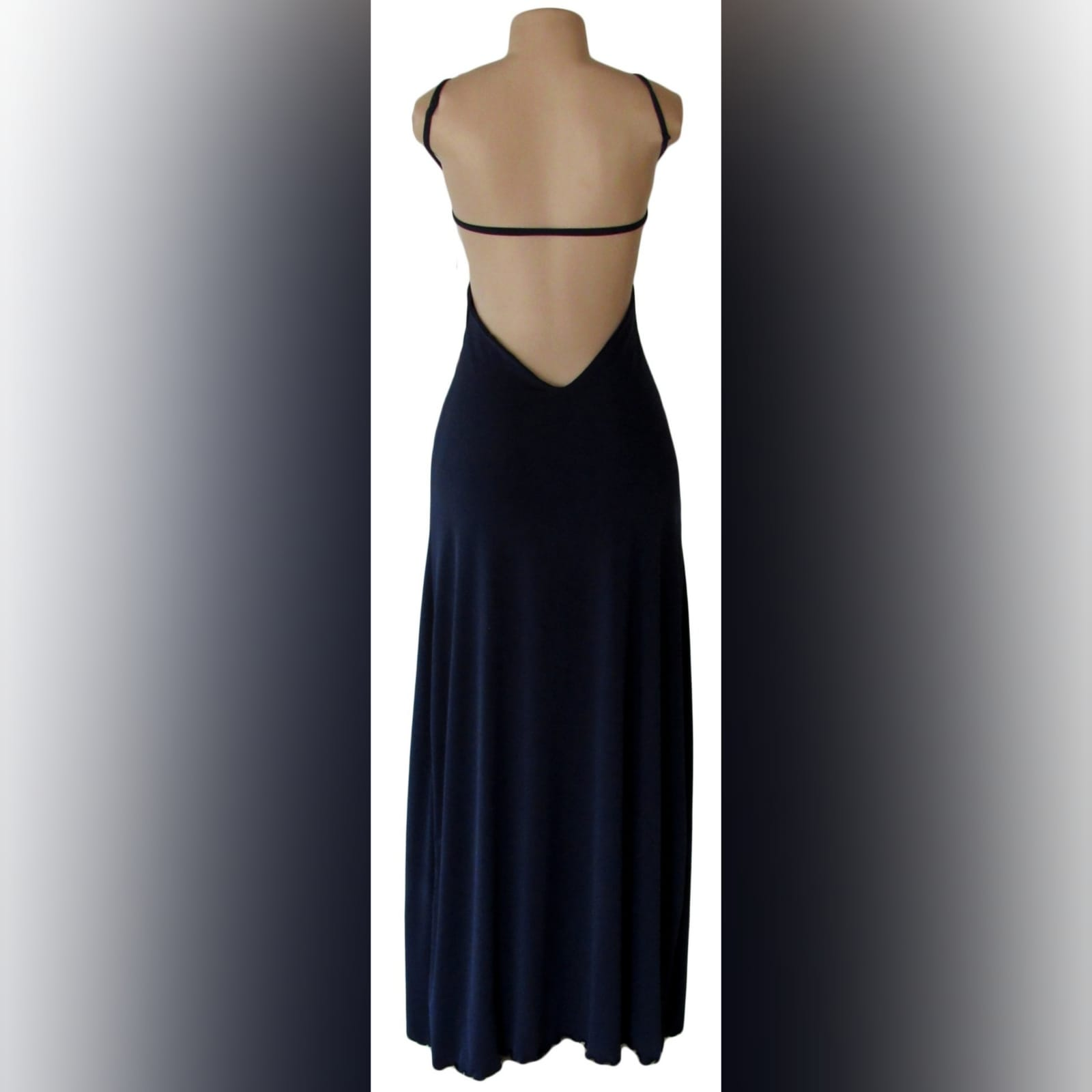 Navy blue long sexy evening dress 3 navy blue long sexy evening dress, with a low open back, side tummy openings and a diamond shaped opening under the bust. With a high slit