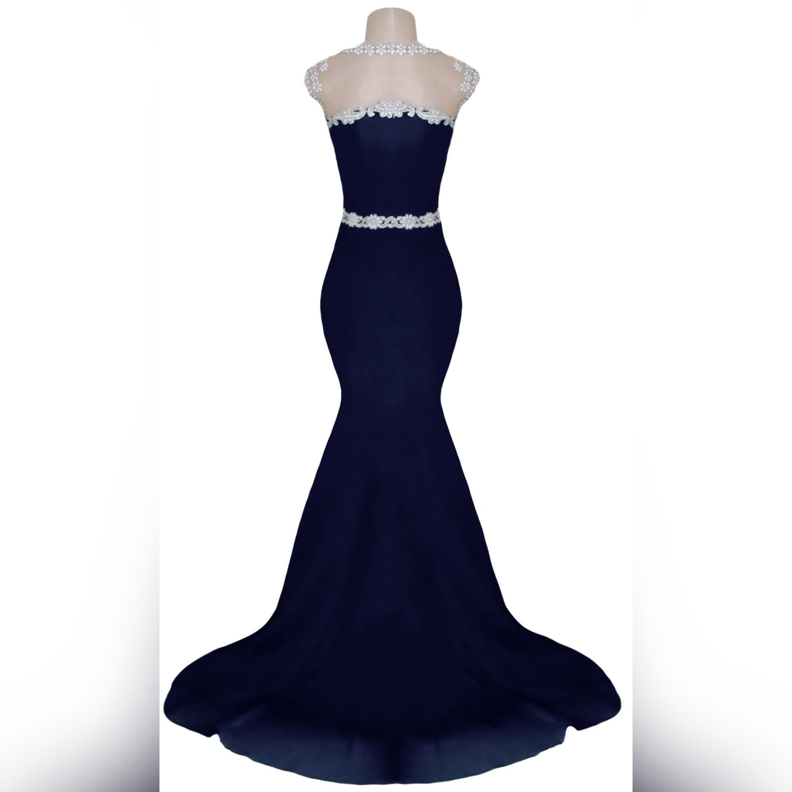 Navy blue & silver soft mermaid formal dress 4 navy blue & silver soft mermaid formal dress. Bodice detailed in silver bling. With a waist belt effect. An illusion neckline and a train.