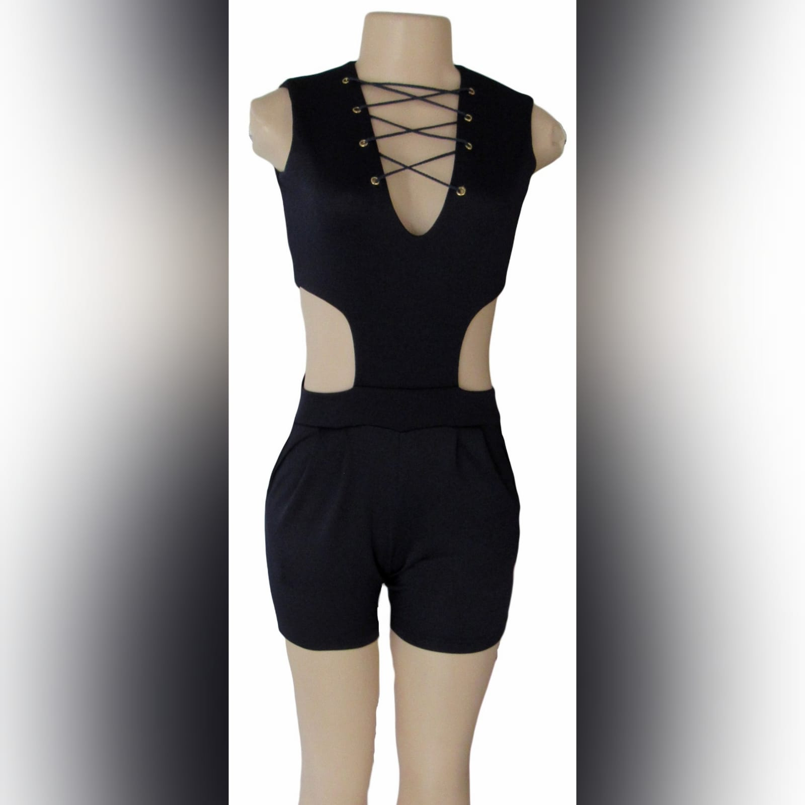 Navy blue smart casual bodysuit 5 navy blue smart casual bodysuit, with side tummy openings, v neckline detailed with lace-up detail, and back with a gold zipper.
