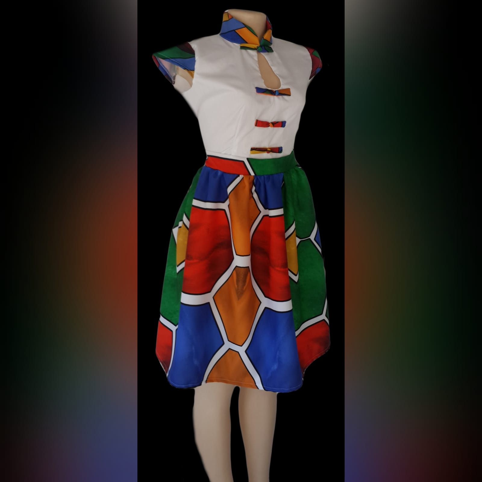 Ndebele dress with white bodice and ndebele print detail 1 traditional ndebele dress, white bodice, chinese collar, cap sleeves and button detail in ndebele print. Bottom of dress in full ndebele print.