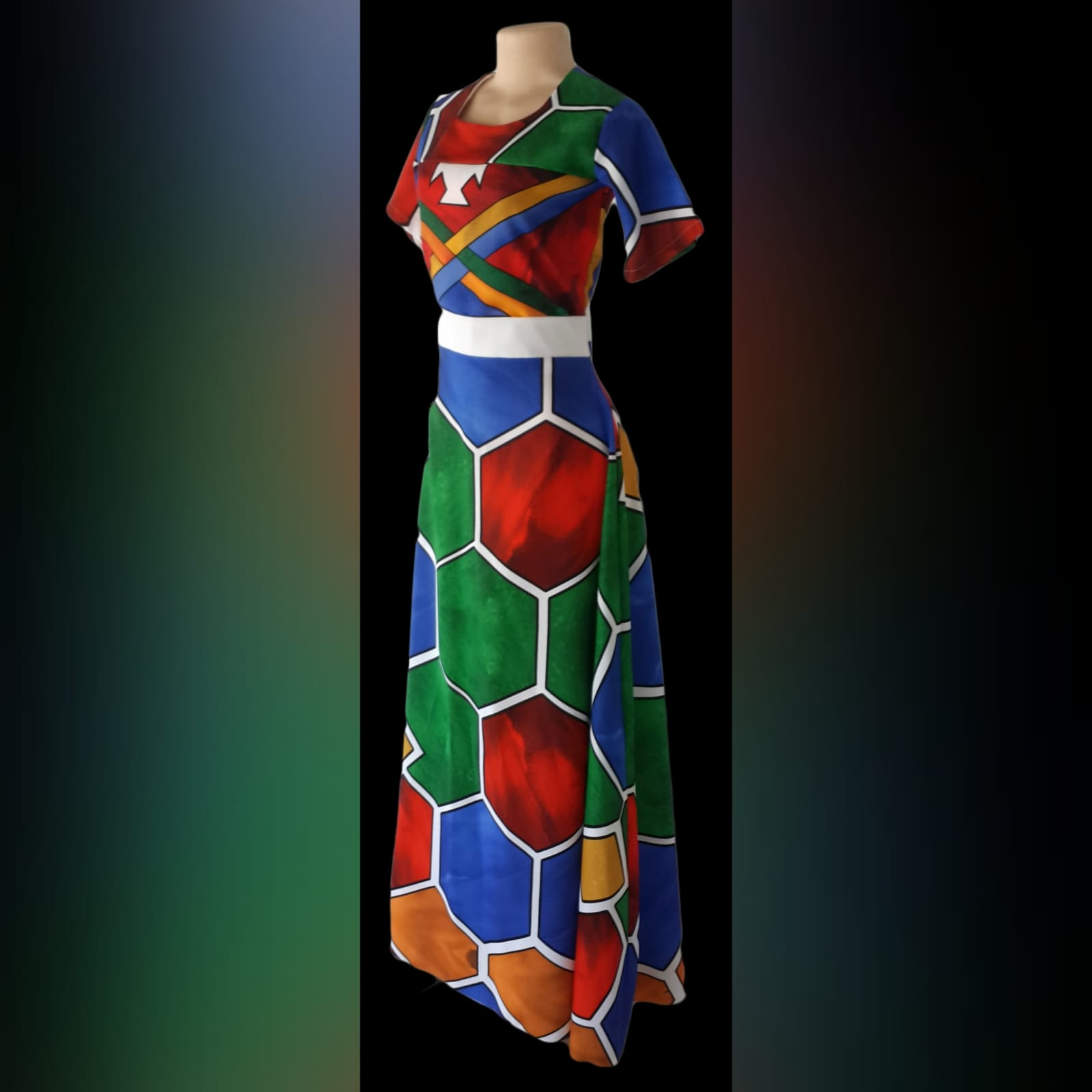 Ndebele empire fit dress with matching shirt 1 custom printed ndebele empire fit, long dress with a white under bust belt with men's matching shirt.