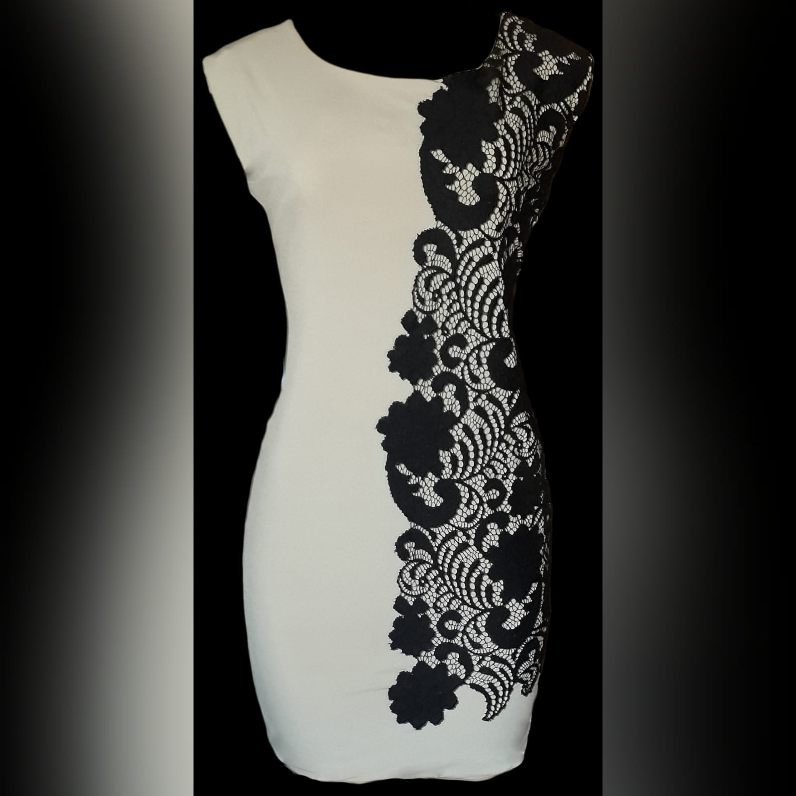 Nude and black mini fitted party dress 3 nude and black mini fitted party dress, one side is nude and one detailed in black lace