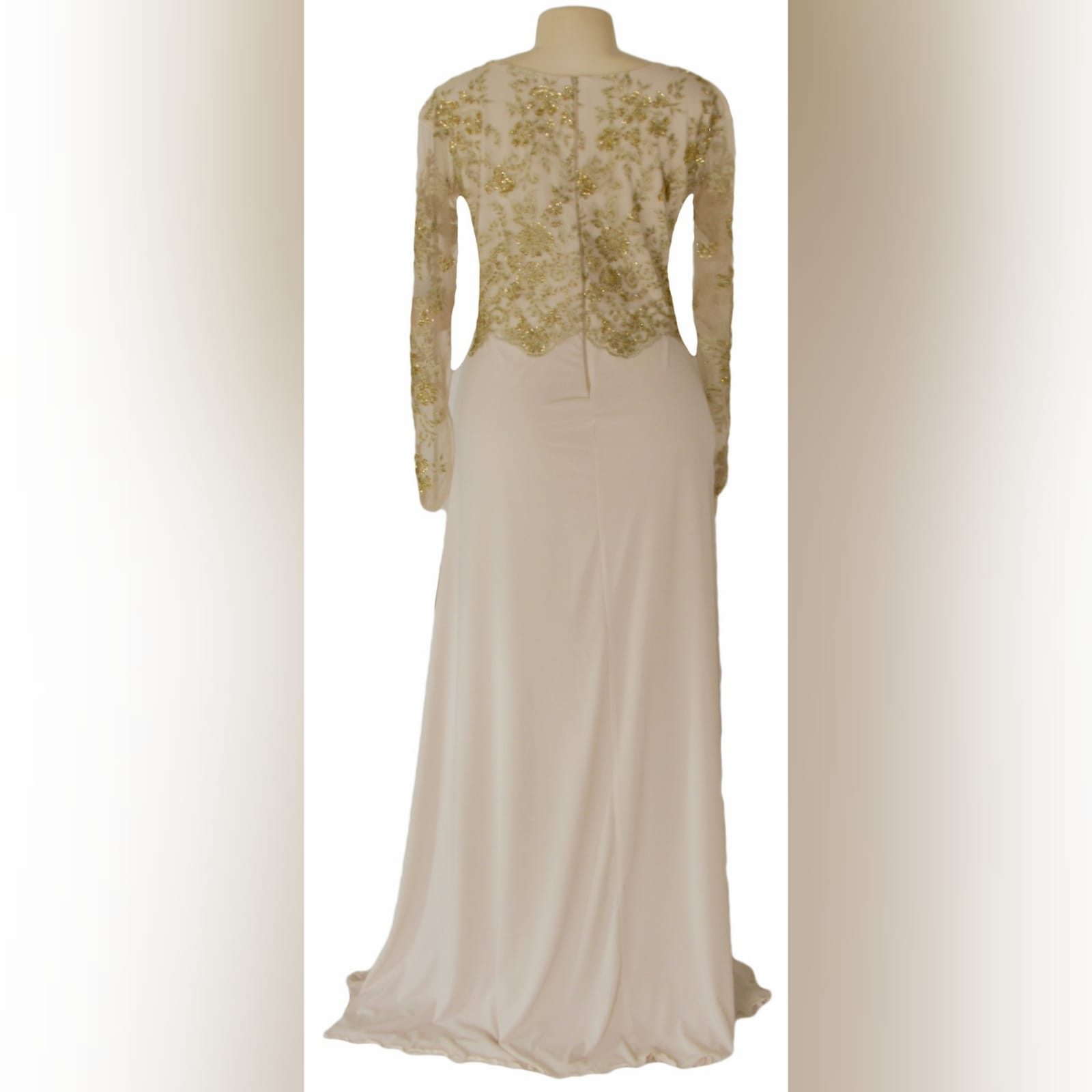 Nude and gold long evening dress 5 nude and gold long evening dress. Bodice detailed with gold beaded lace with long she sleeves, with a slit