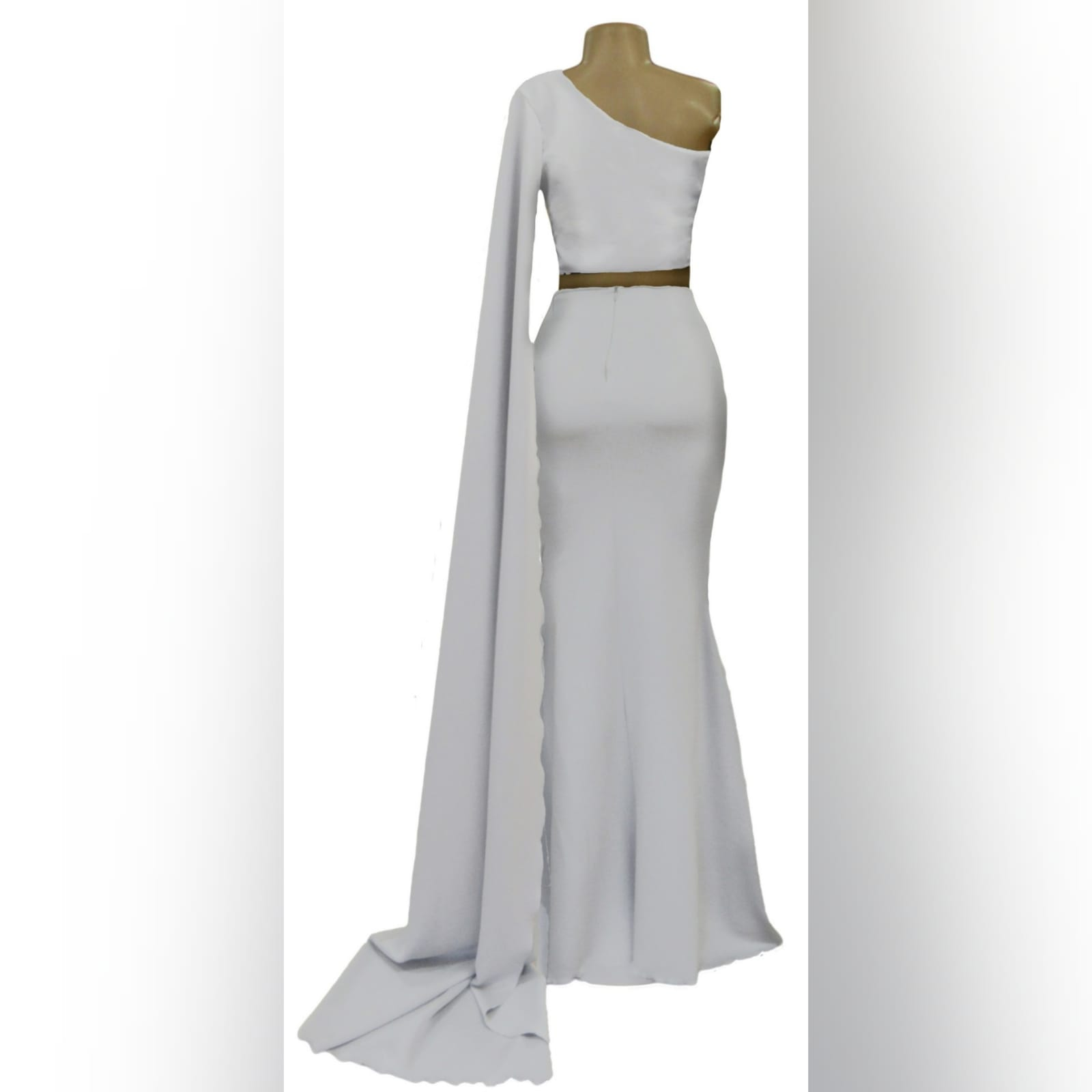 Pale grey 2 piece mermaid prom dress 3 pale grey 2 piece mermaid prom dress. Fitted crop top with wide single sleeve creating a train. Mermaid skirt with a little train.