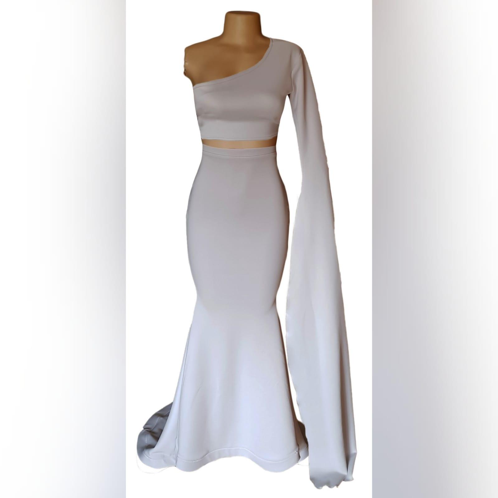Pale grey 2 piece mermaid prom dress 4 pale grey 2 piece mermaid prom dress. Fitted crop top with wide single sleeve creating a train. Mermaid skirt with a little train.