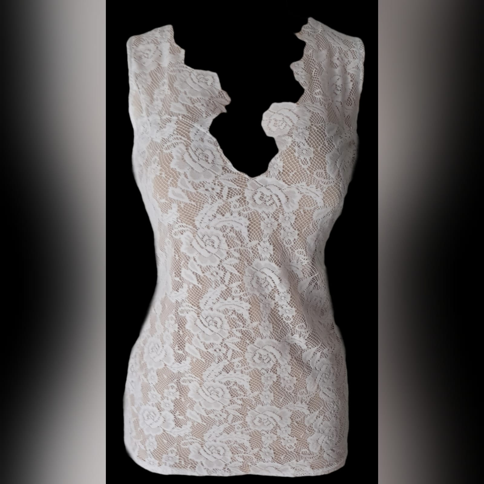 Peach and white 2 piece evening dress 2 peach and white 2 piece evening dress. Mini lace dress with a low open back, with a detachable back peach train