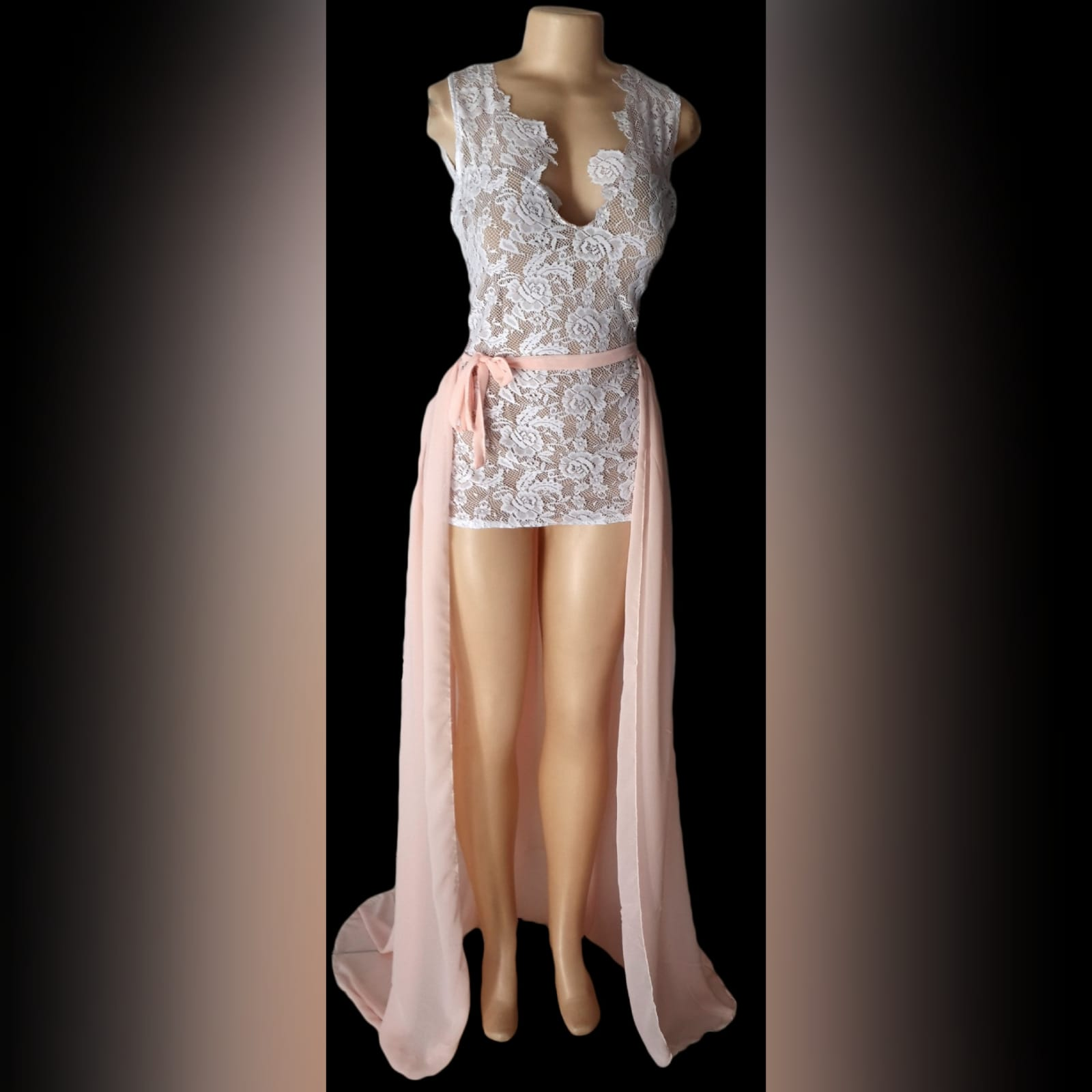 Peach and white 2 piece evening dress 1 peach and white 2 piece evening dress. Mini lace dress with a low open back, with a detachable back peach train