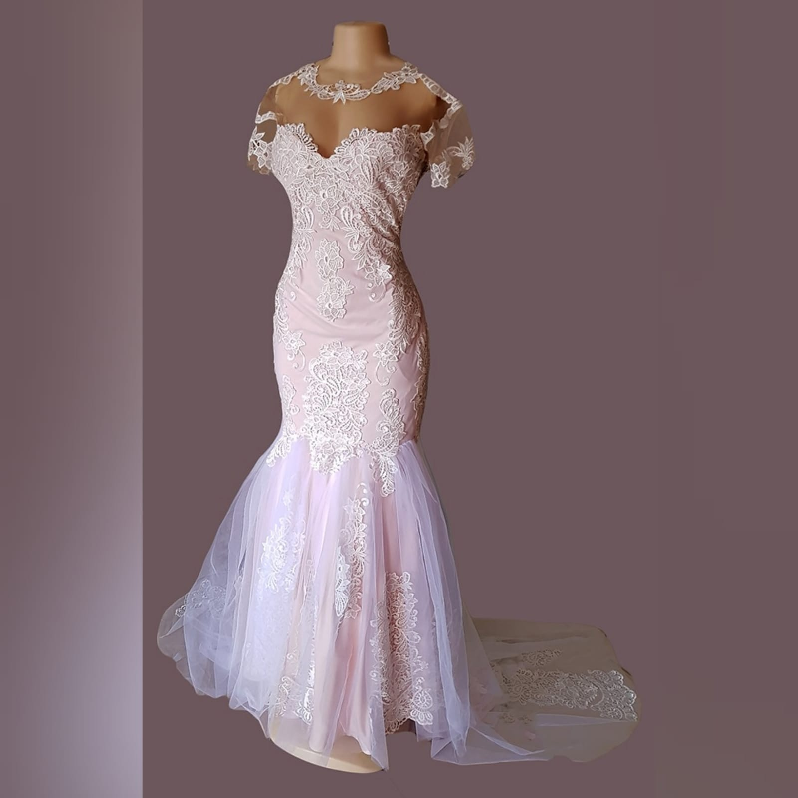Pink nude & white tulle mermaid wedding dress 4 pink nude & white tulle mermaid wedding dress with a lace bodice, mermaid & train detailed with lace, illusion neckline with cap sleeves detailed with lace.