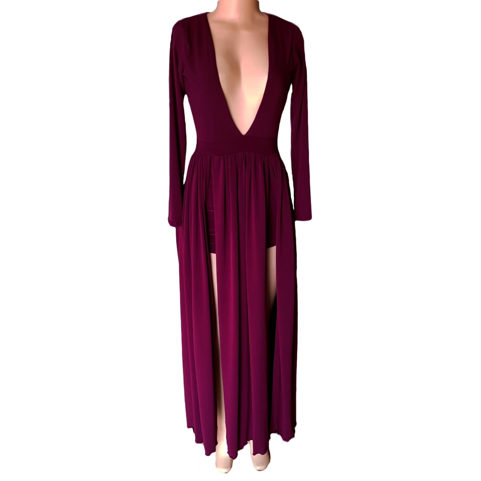 Plum flowy plunging neckline prom dress 4 plum flowy plunging neckline prom dress with long sleeves & 2 high slits and a train with matching shorts.