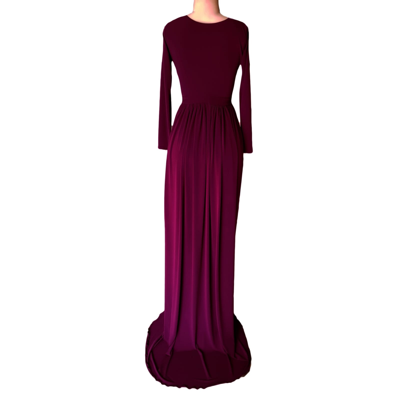 Plum flowy plunging neckline prom dress 3 plum flowy plunging neckline prom dress with long sleeves & 2 high slits and a train with matching shorts.